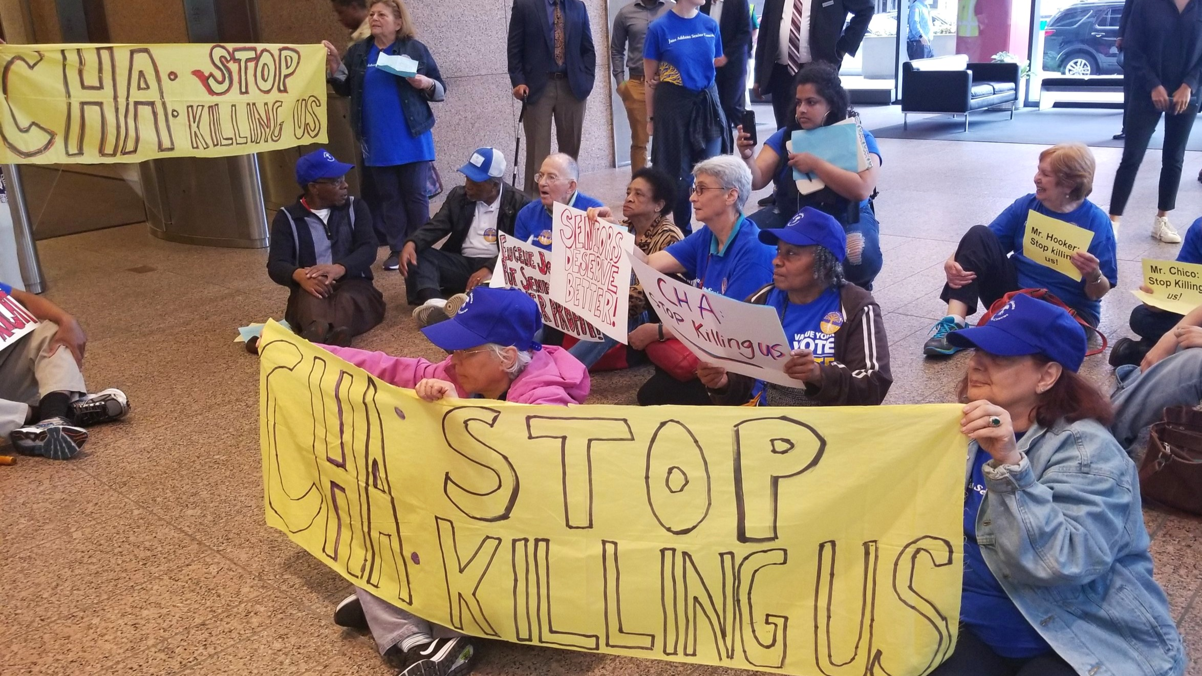JASC leaders disrupt a Chicago Housing Authority Board meeting to demand safer living conditions in CHA buildings.