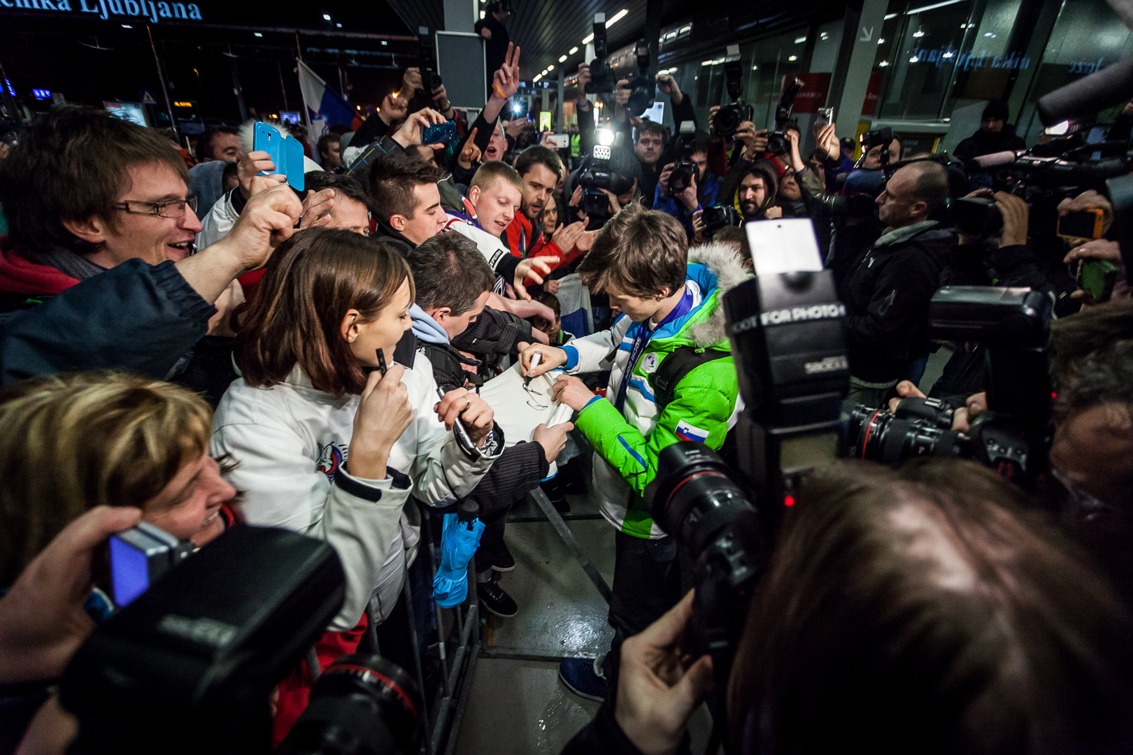Peter Prevcsigns autographs after returning from Olympics with silver and bronze.