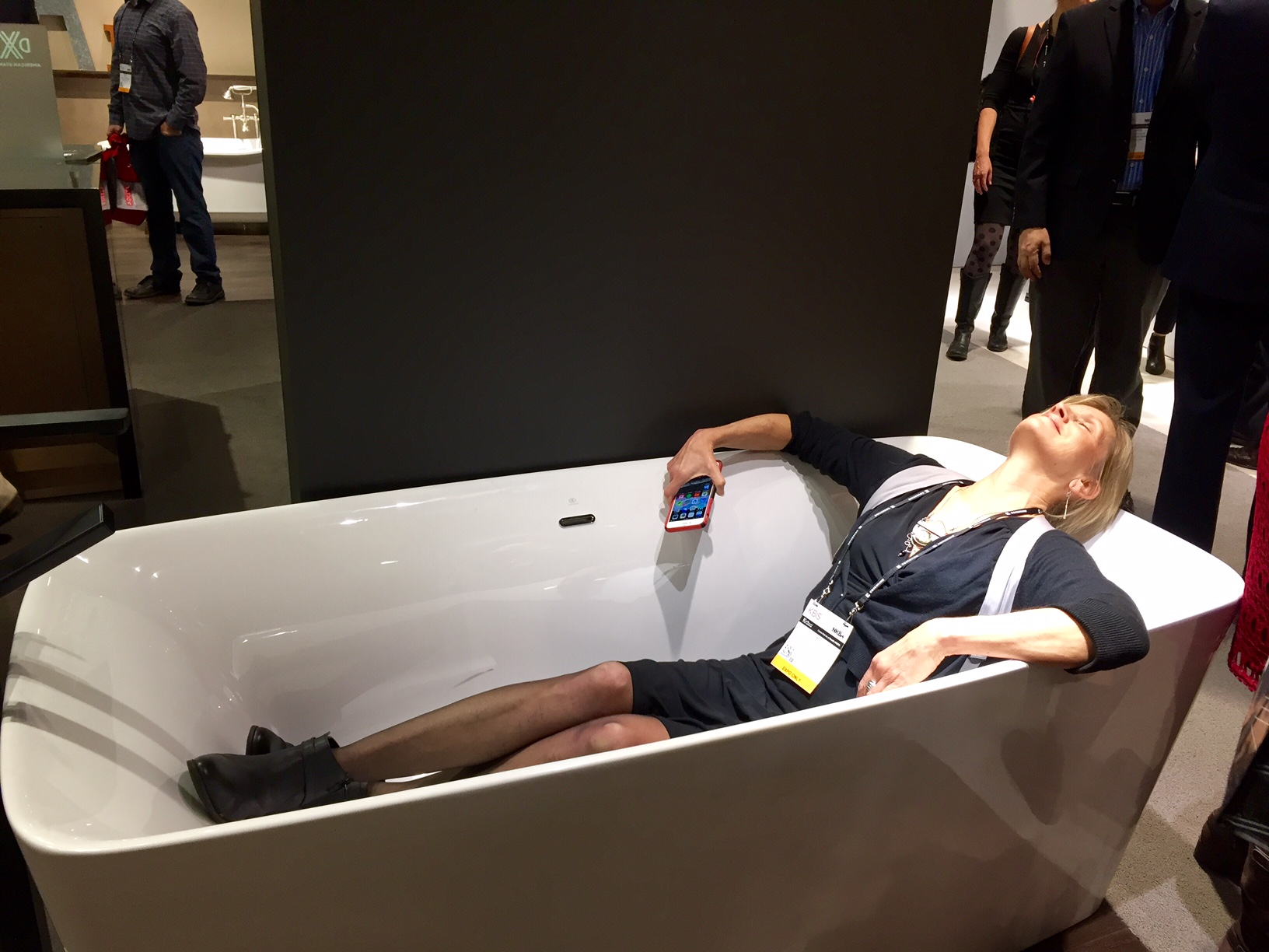Pam testing out one of American Standard's freestanding tubs