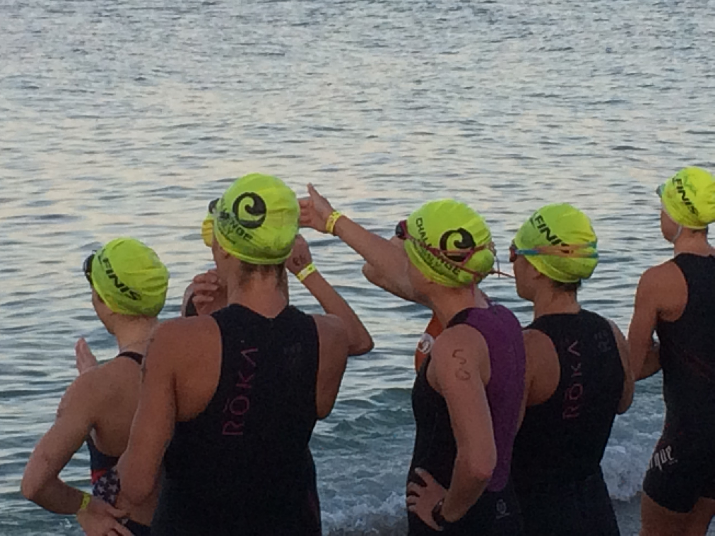 Carly (on the left) and I (number 50) scoping out the swim course.