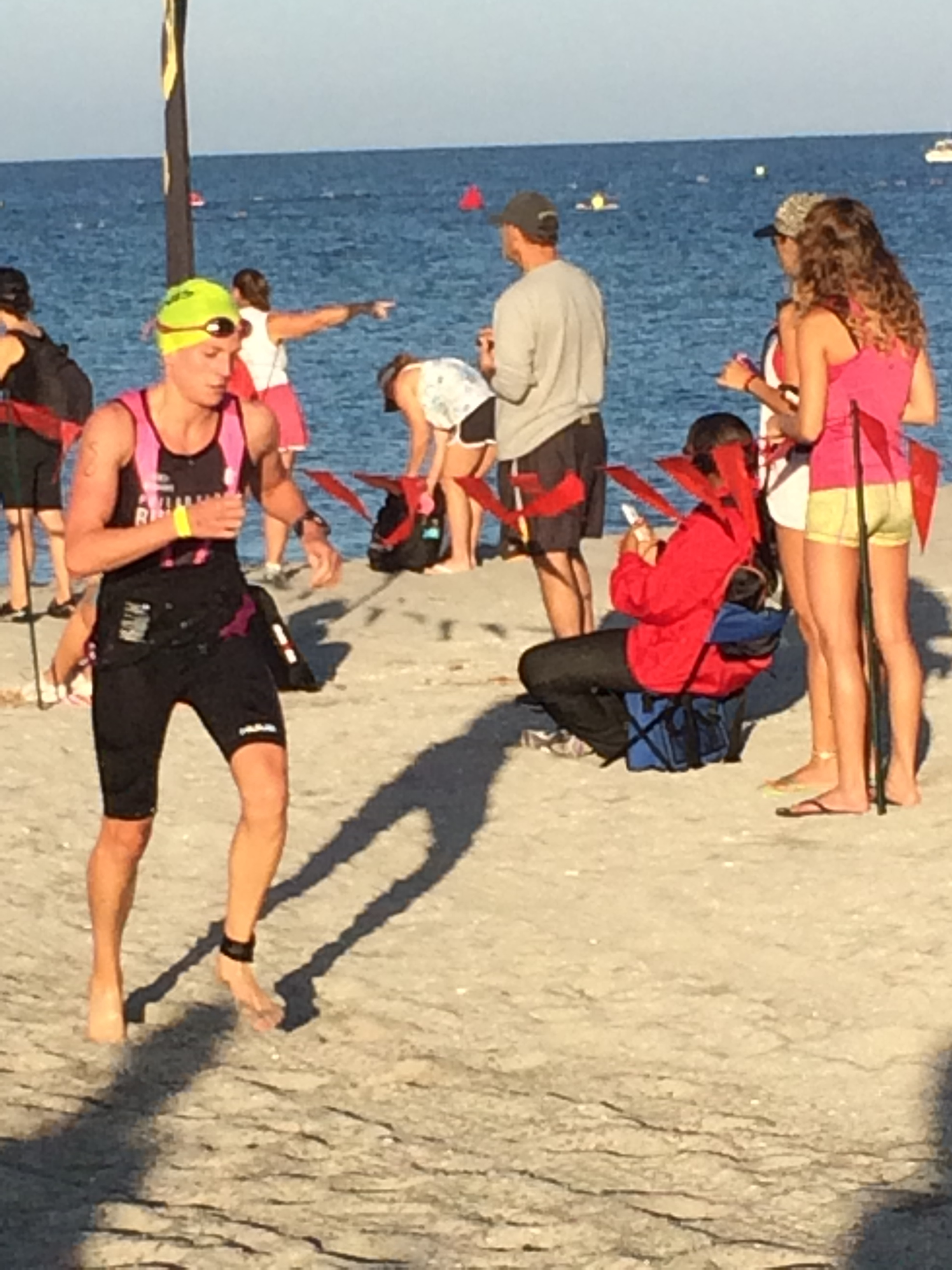Exiting the swim and running across the beach in 5th place.
