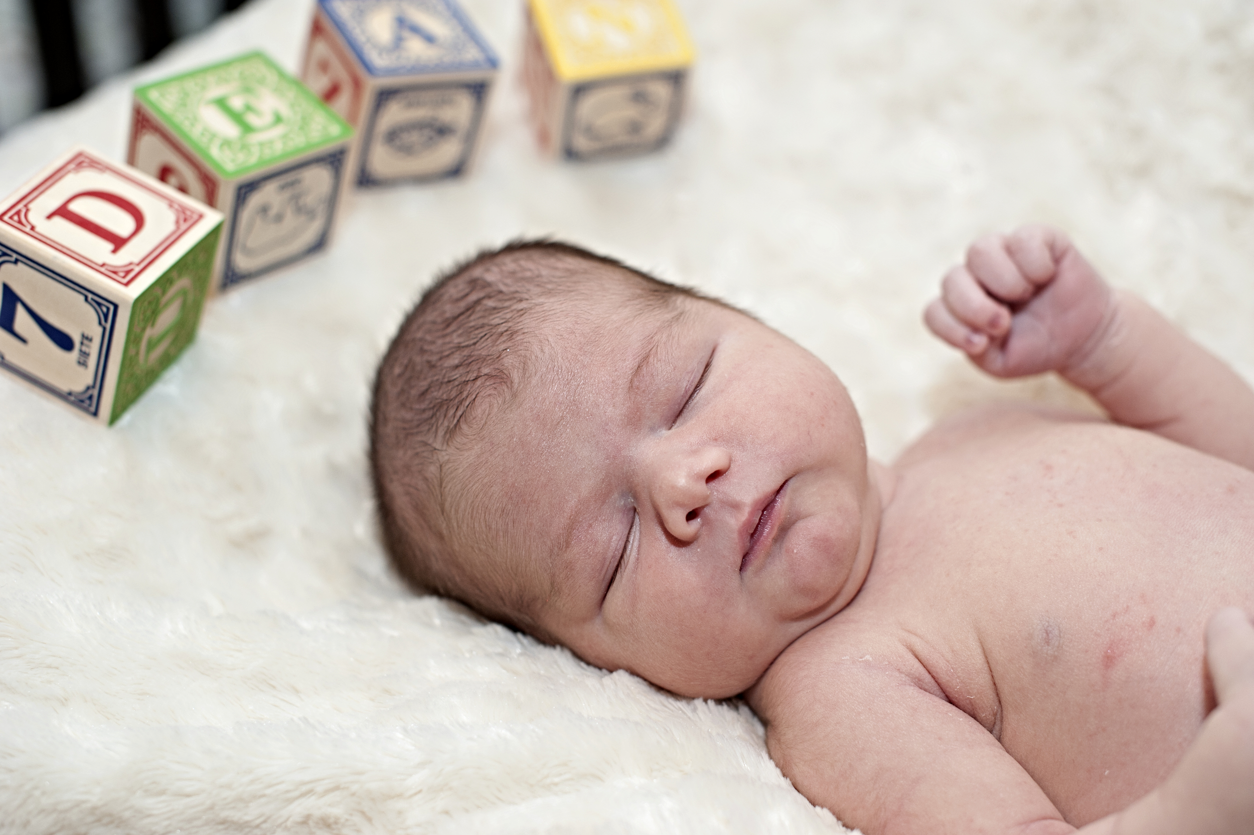 Just a week old and already the light of my life and the constant subject of photography!