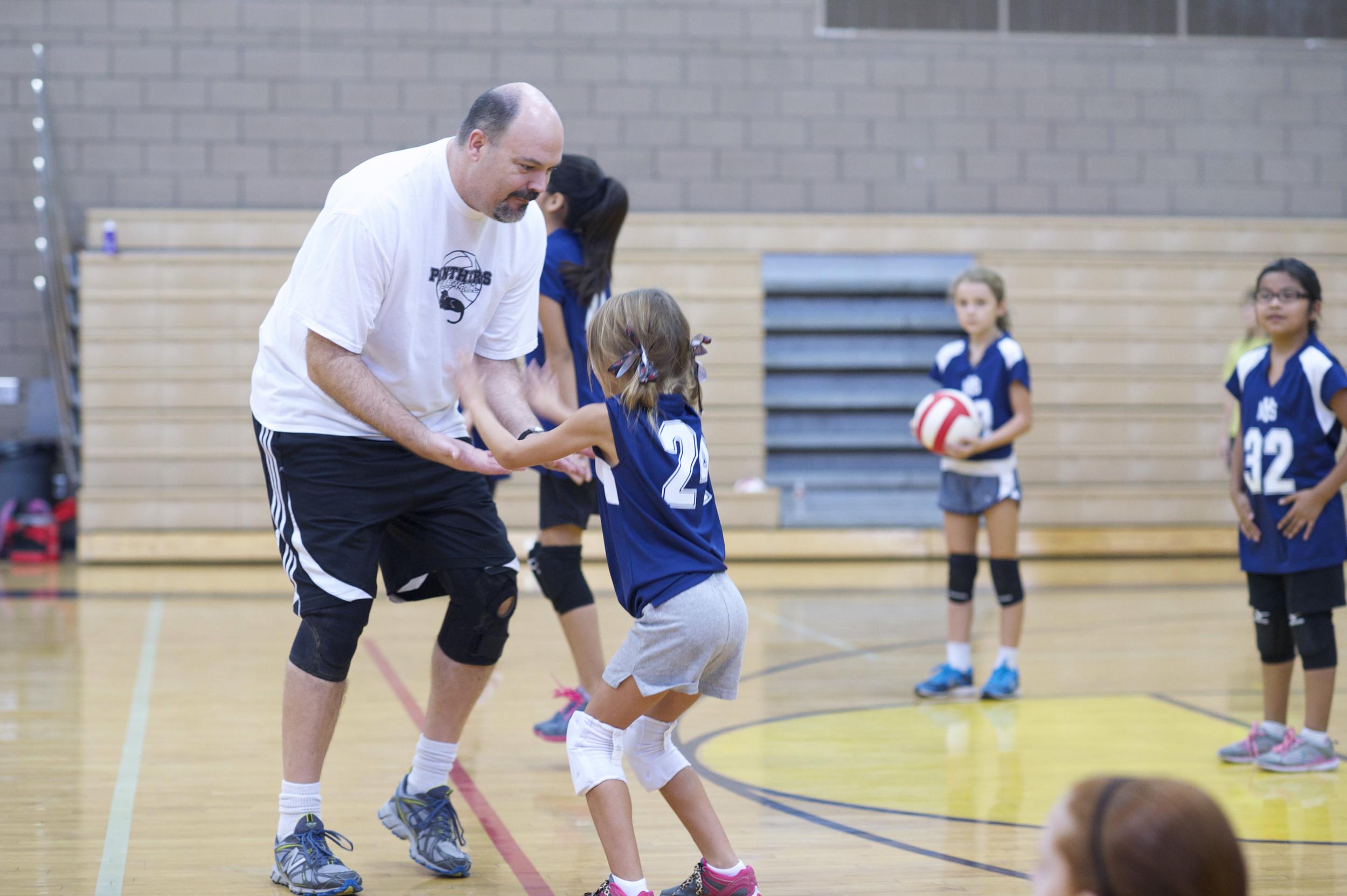 Coach giving the girls a little encouragement!
