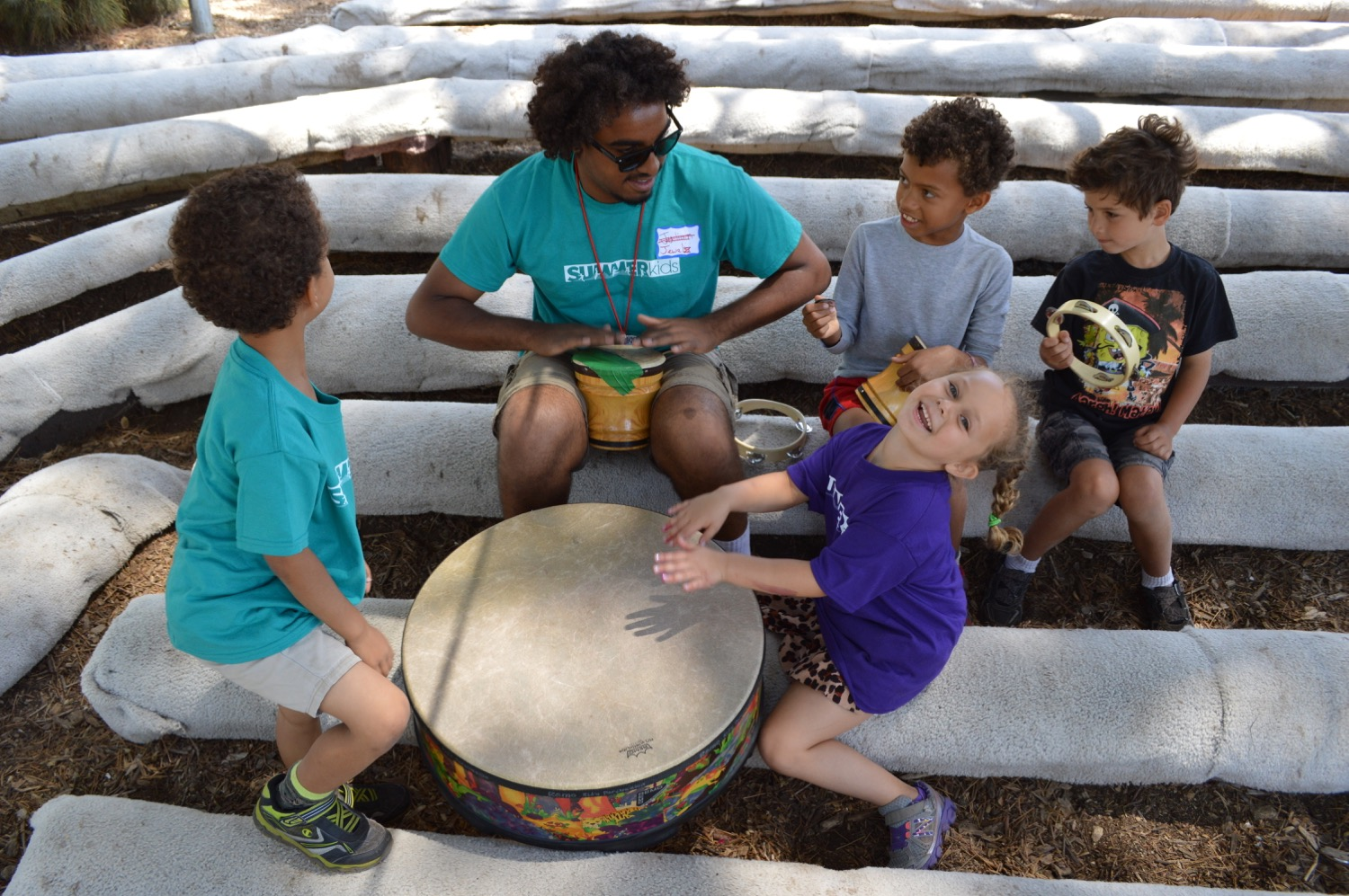 play in a camp drum circle,