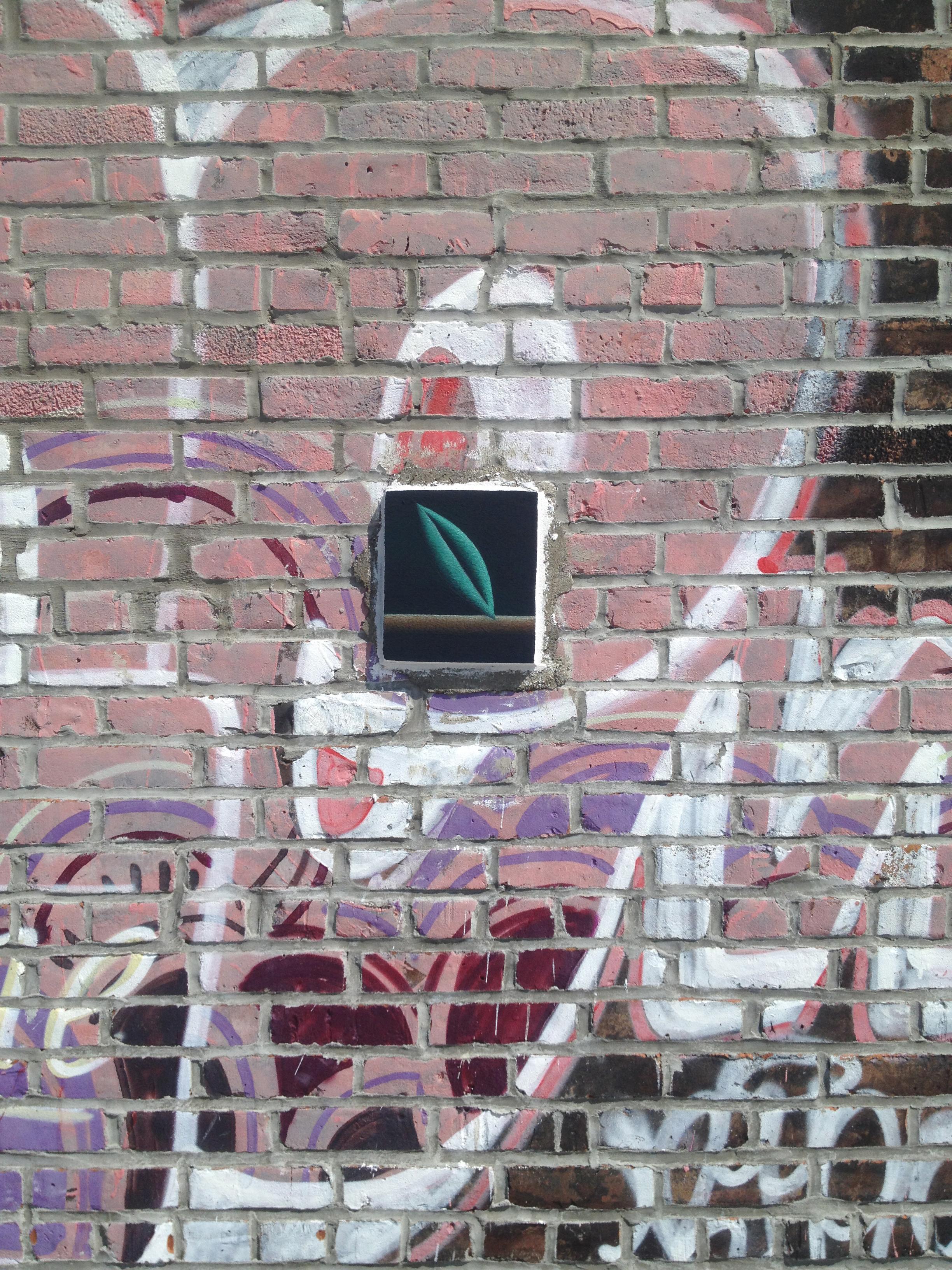 Nadia  Ayari  ,Out (Escape BFTS),2014, fresco and concrete on brick, approx 7h x 5w in / 17.8h x 12.7w cm, Brooklyn, New York