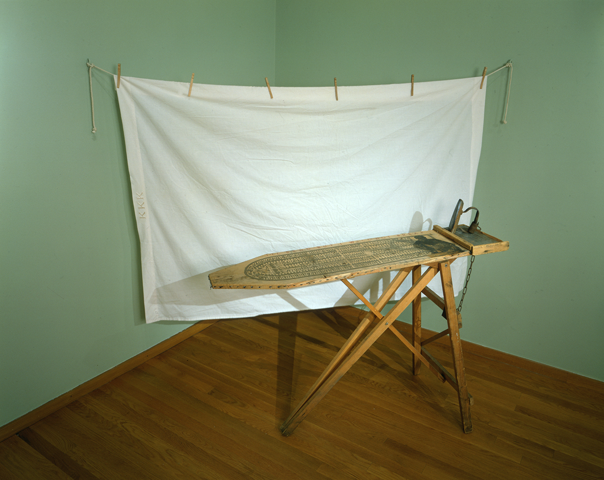 "Betye Saar (b.1926)  I'll Bend But I Will Not Break , 1998 vintage ironing board and iron installation 80"" x 96"" x 36"", signed and dated Credit Line: Courtesy of Michael Rosenfeld Gallery LLC, New York, NY"