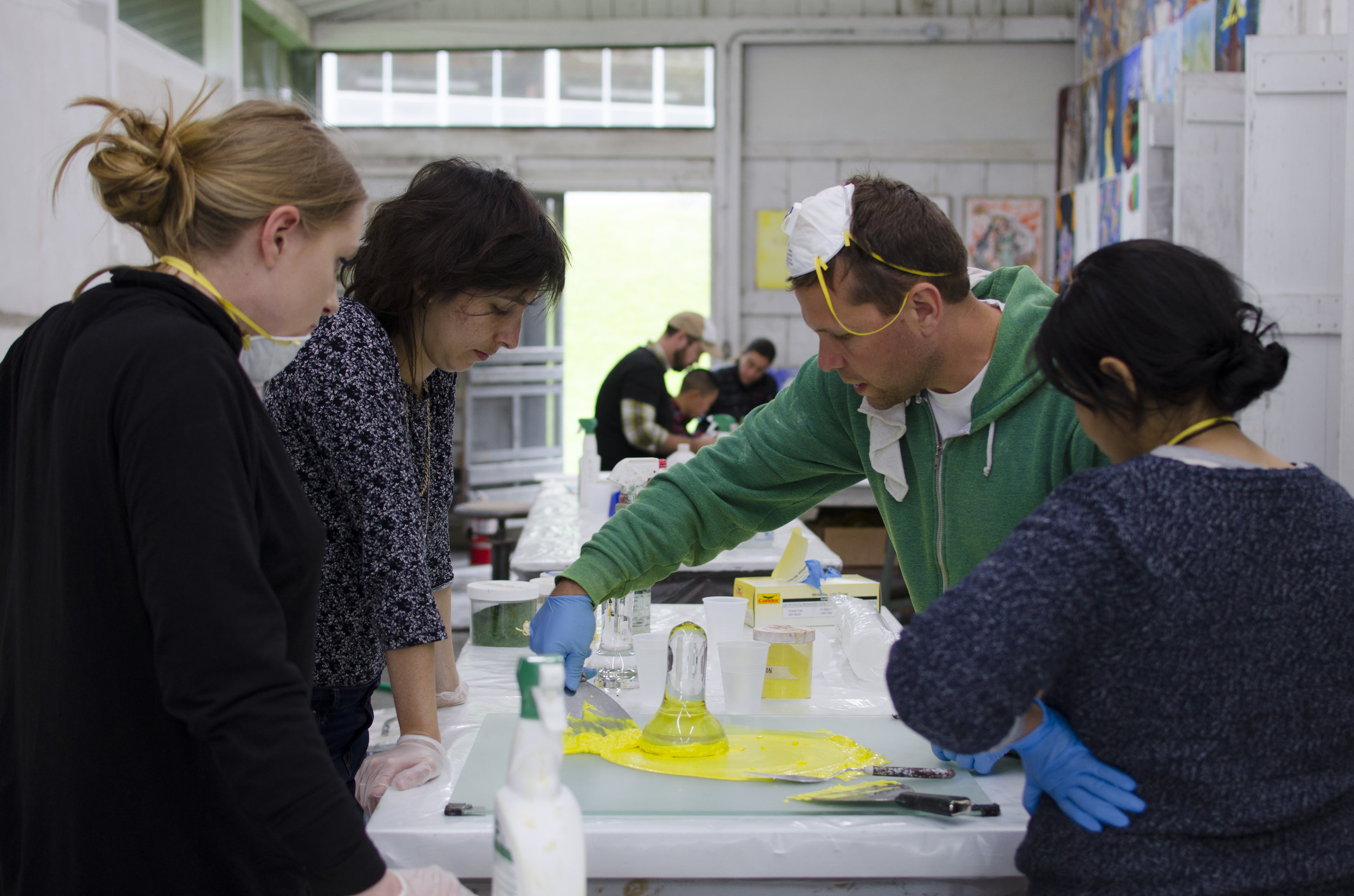 Sean Glover (A '03) and participants preparing pigments for fresco, 2015.