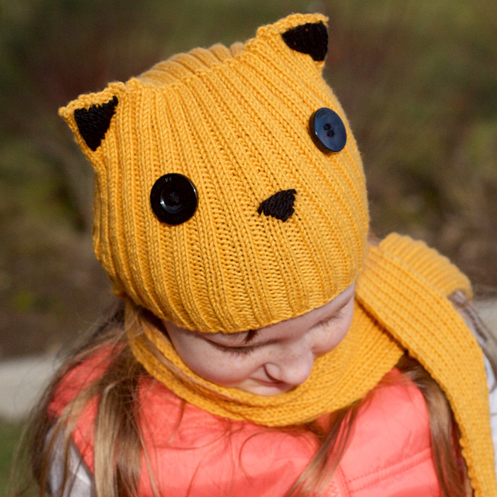 Growltiger  is a super-simple kids' knit incorporating hat and scarf into one easy-to-wear item. Worked in DK yarn and featuring irresistible kitty ears plus two tutorials for really easy, really useful techniques.   Buy now   on Ravelry.