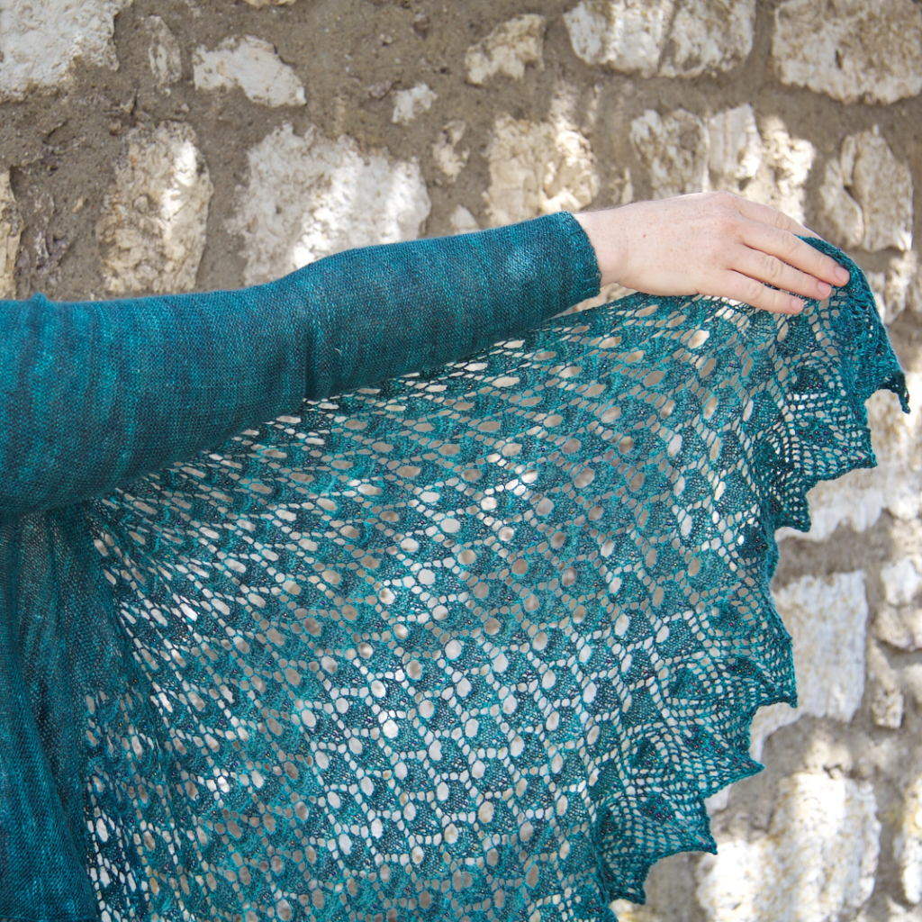 Pavonis is a beautifully wearable sleeved wrap, worked end to end with deep, dramatic beaded lace borders. The sizing is highly adjustable for a perfect fit. Pattern includes four tutorials.  Buy now  on Ravelry.