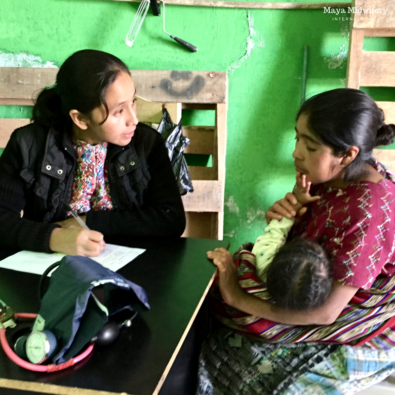 Imelda listens carefully to her patient in one of Maya Midwifery's mobile clinics.
