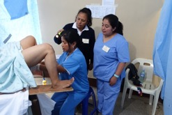 Midwives learn to perform pelvic exams and cervical cancer screenings
