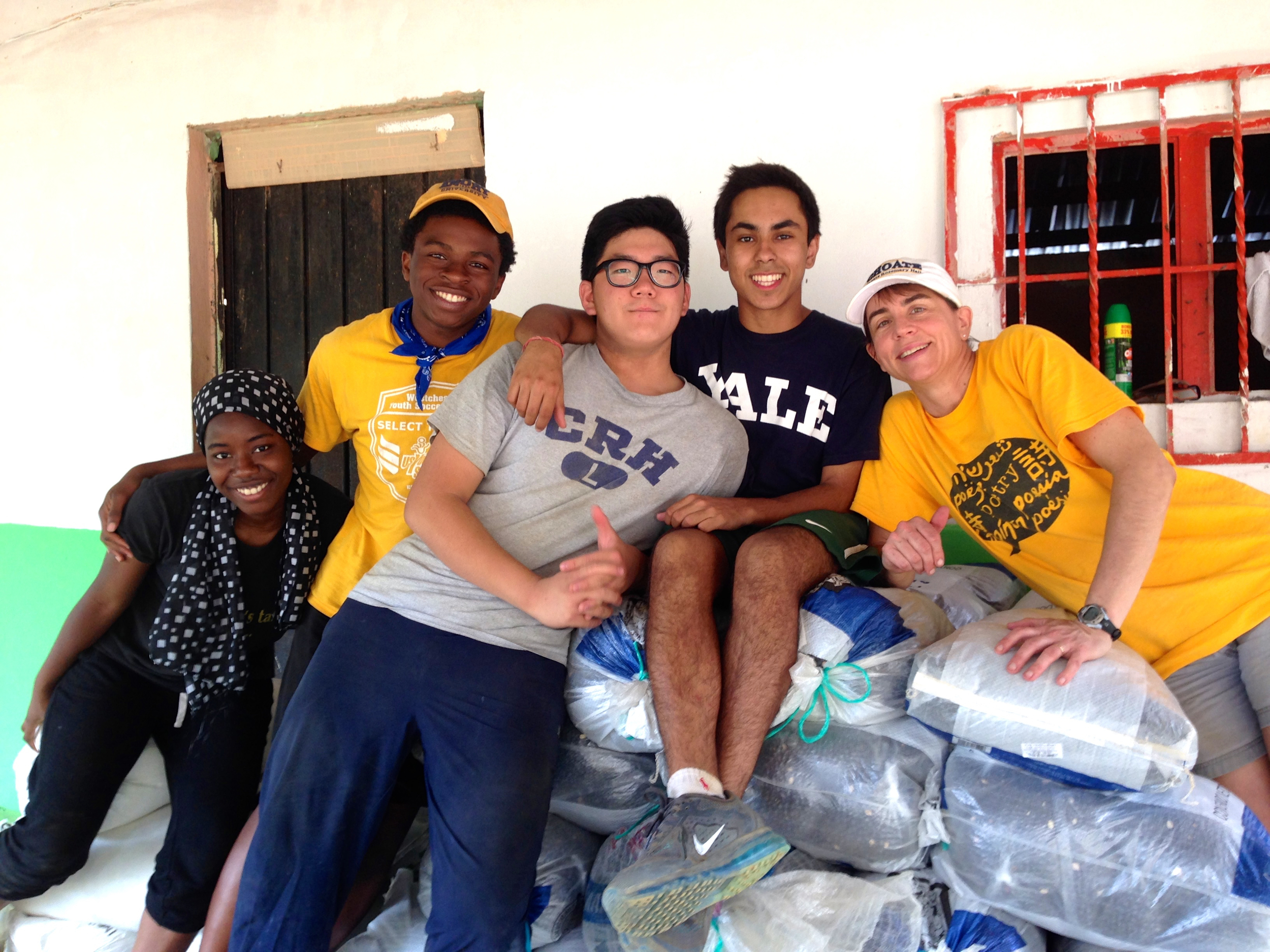YJ, center, works with his fellow Choate service team members to prepare for our food distribution program, or despensa, in the Oaxacan jungle town of Santa Maria Tepexipana.