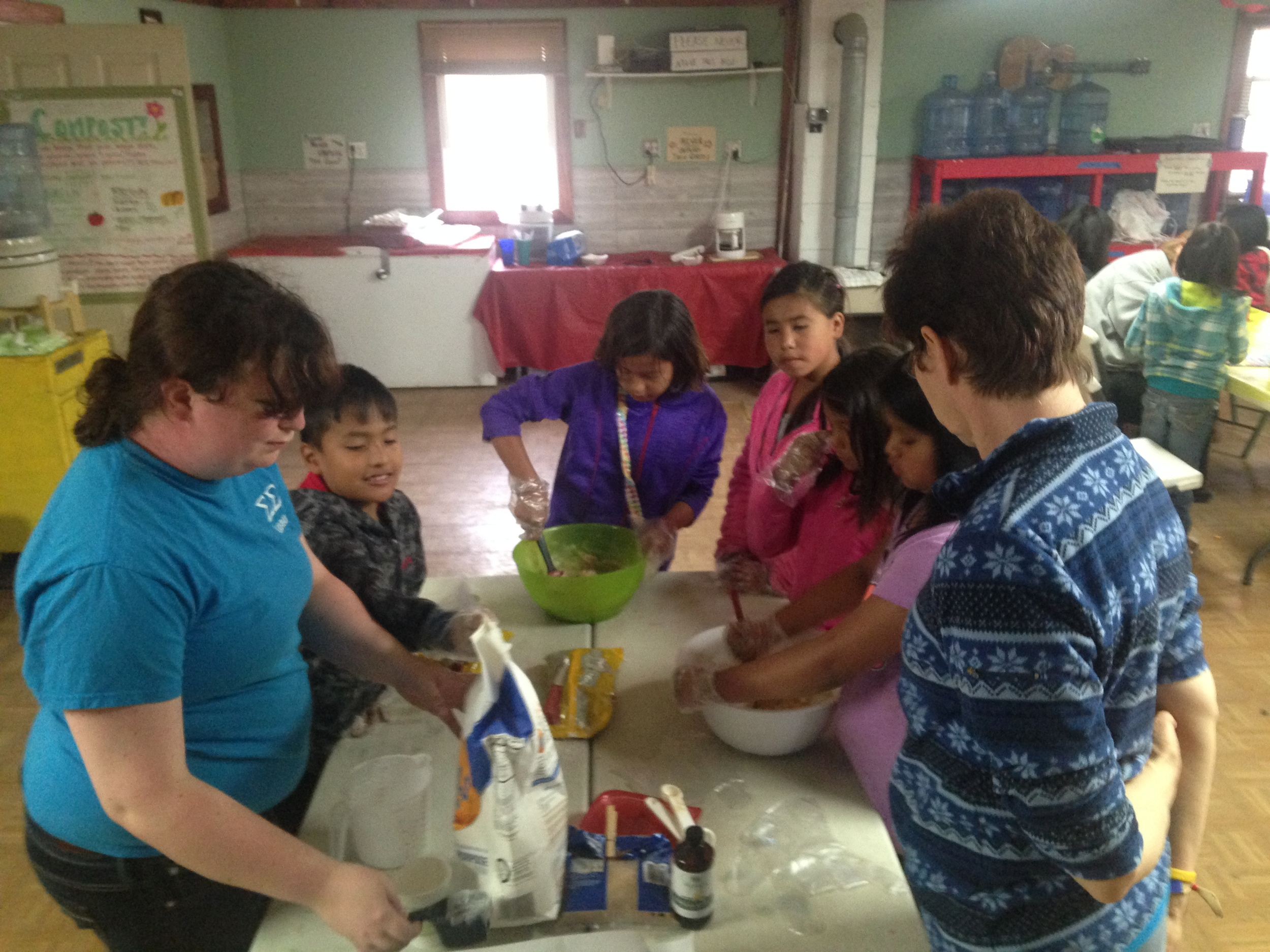 Fun with food:  The kids make chocolate chip cookies with Rachel and Laura Westby for the town-wide meal on Friday!