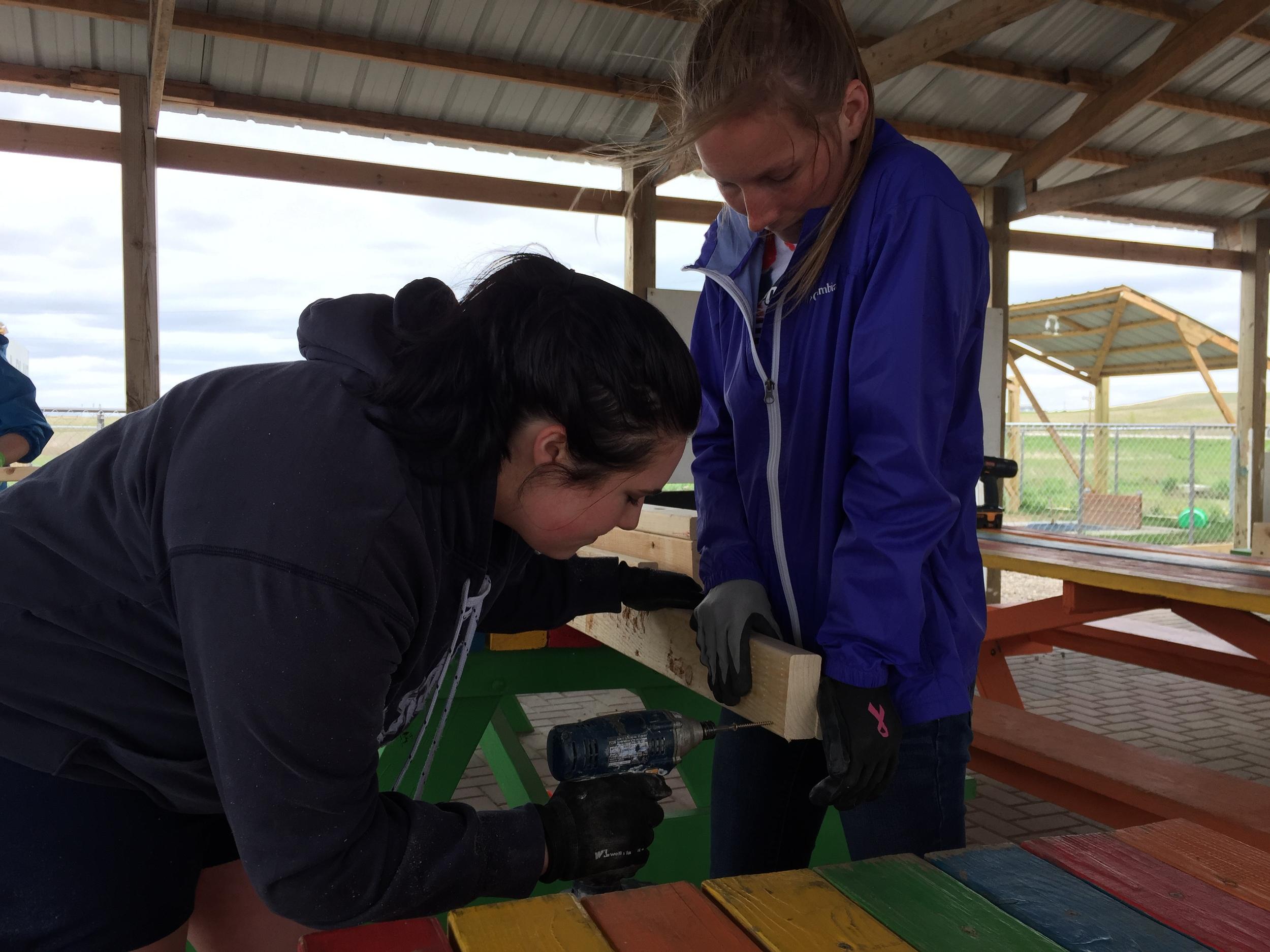 The UWSP crew starts building bunk beds!