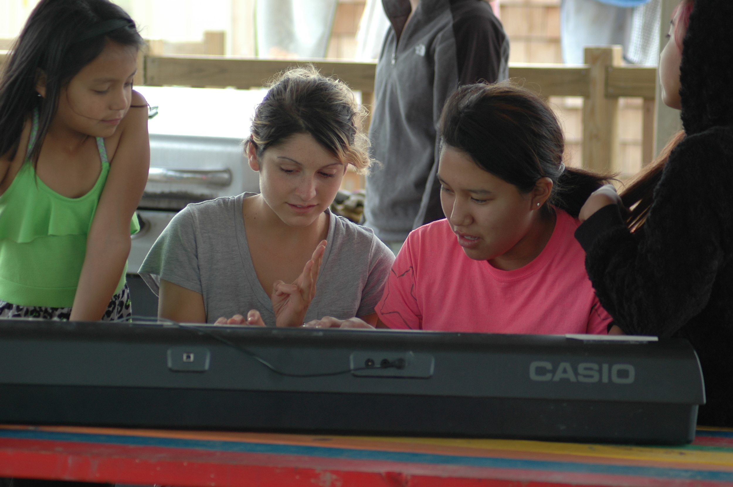 Vanessa teaches the kids a few new tunes during camp! (A.Gross, La Plant, May 2015)