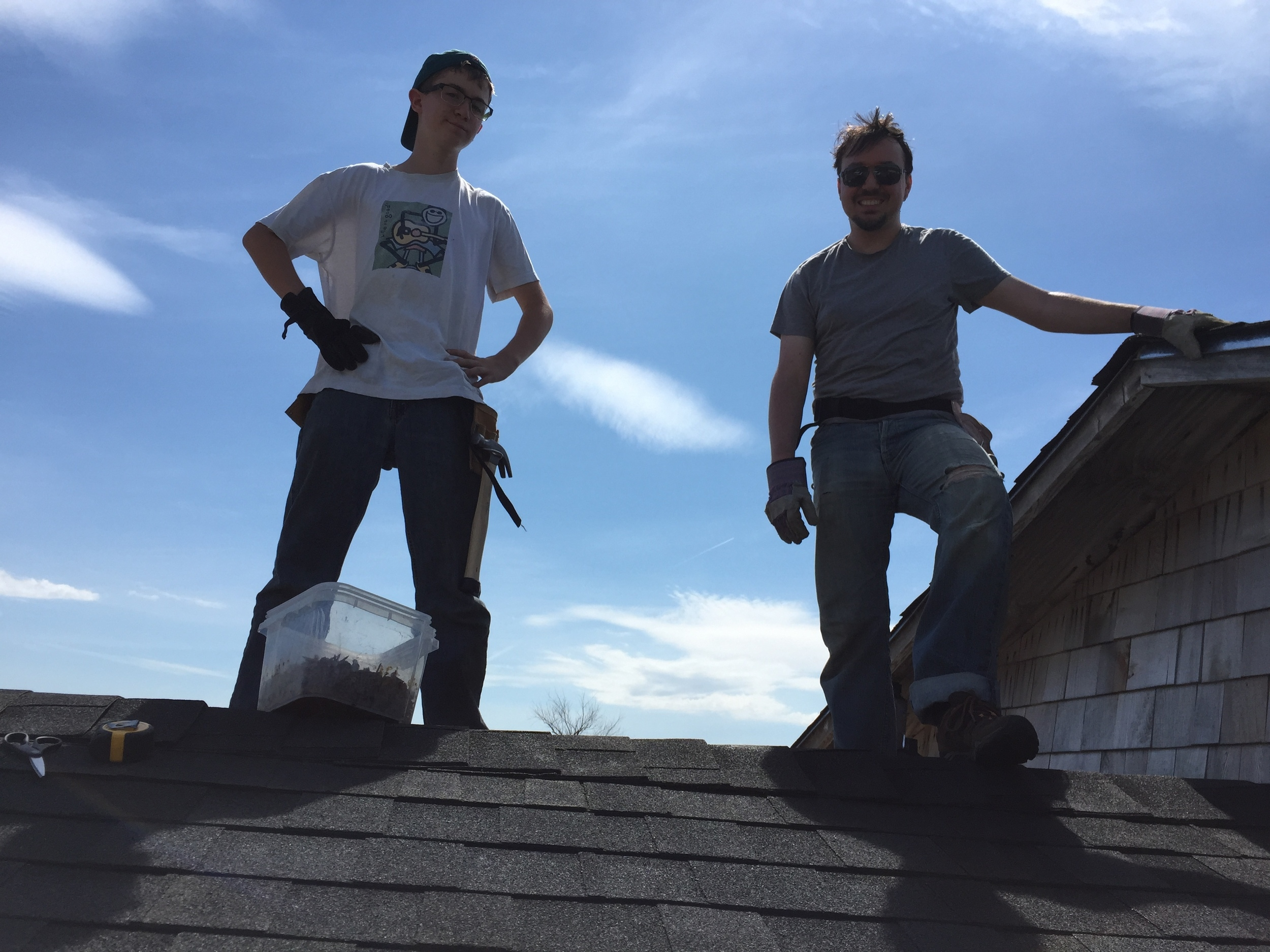Calvin and Stefan became expert roofers as they shingled a part of the community center roof that was damaged by high winds. (Z. Gross, June 2015)