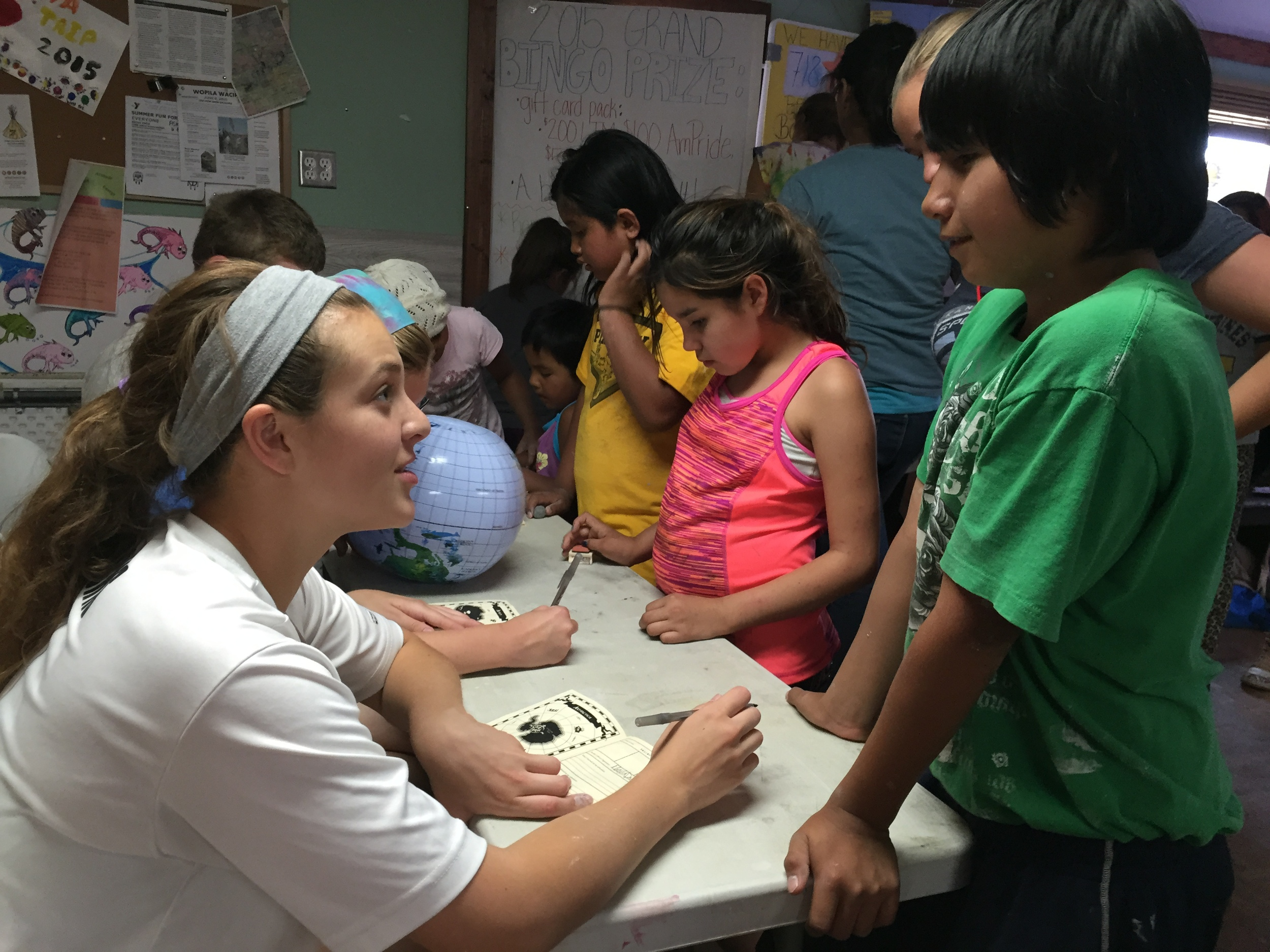 """As part of Plymouth's """"around the world"""" theme for camp this week, the kids received passports that will be stamped each day as they experience different continents through various crafts and games. (Z.Gross, June 2015)"""