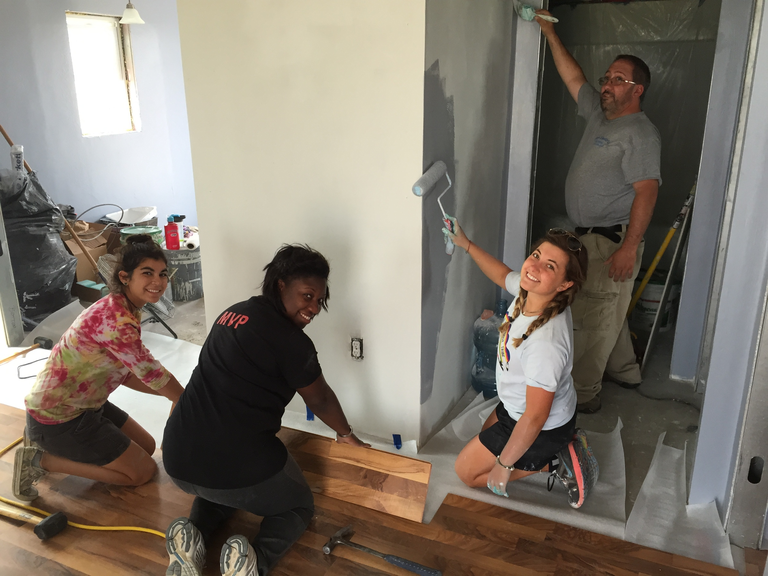 "Smiles abound among our interns and volunteers at the new house project, including Nakia Letang, associate director of admissions at Fairfield University, and Dom Mastroni, from Milford, CT! (Z. Gross, August 2015, La Plant"")"