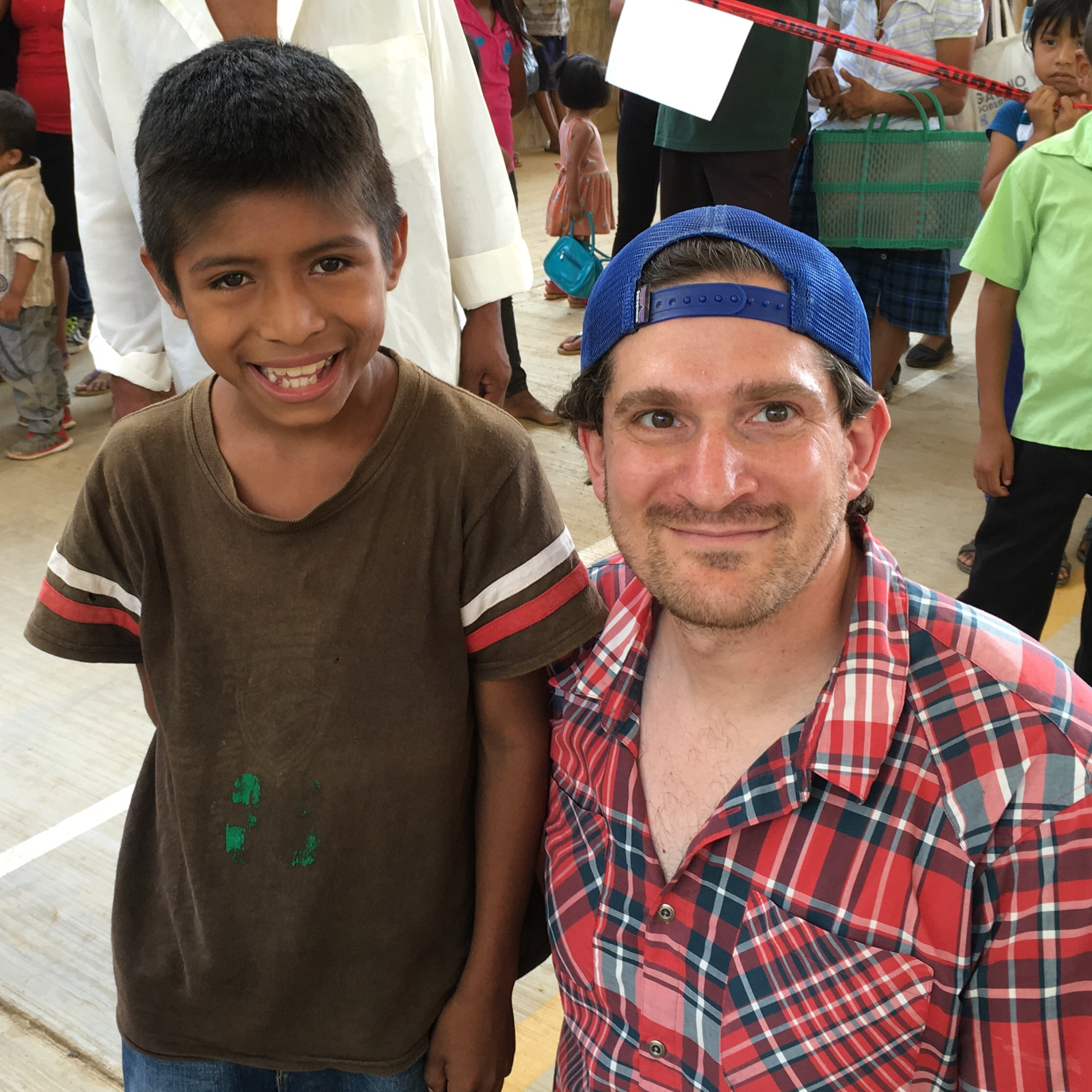 Simply Smiles President & Founder, Bryan Nurnberger with one of the children he encountered on his first trip to the Oaxacan villages. At the time, Rigoberto was suffering from severe parasitic infection. Pictured here at Thursday's clinic (5/26/16) Rigoberto is healthy and attending one of the schools Simply Smiles built in the region.