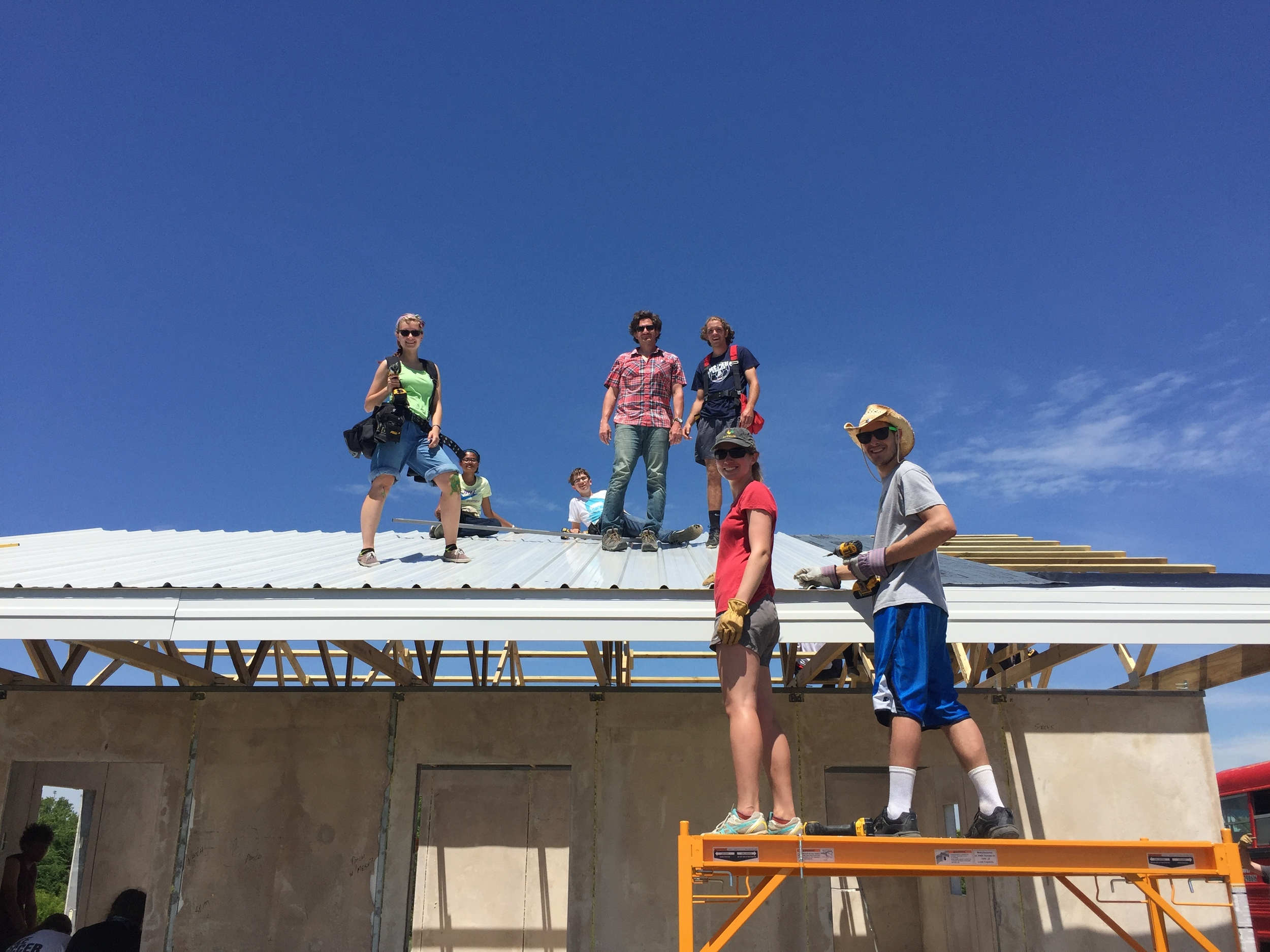 Taking great heights to build strong, safe, secure homes:  Thanks to our amazing volunteers and interns who worked alongside Bryan to put the roof on Ford's new home!