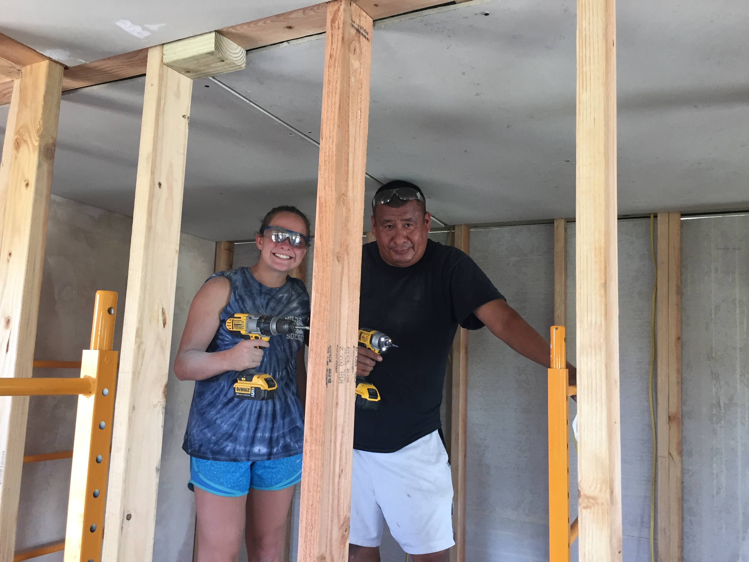 Working side-by-side: Volunteer Katie works with Shane of La Plant to frame in a bathroom ceiling on a new home.