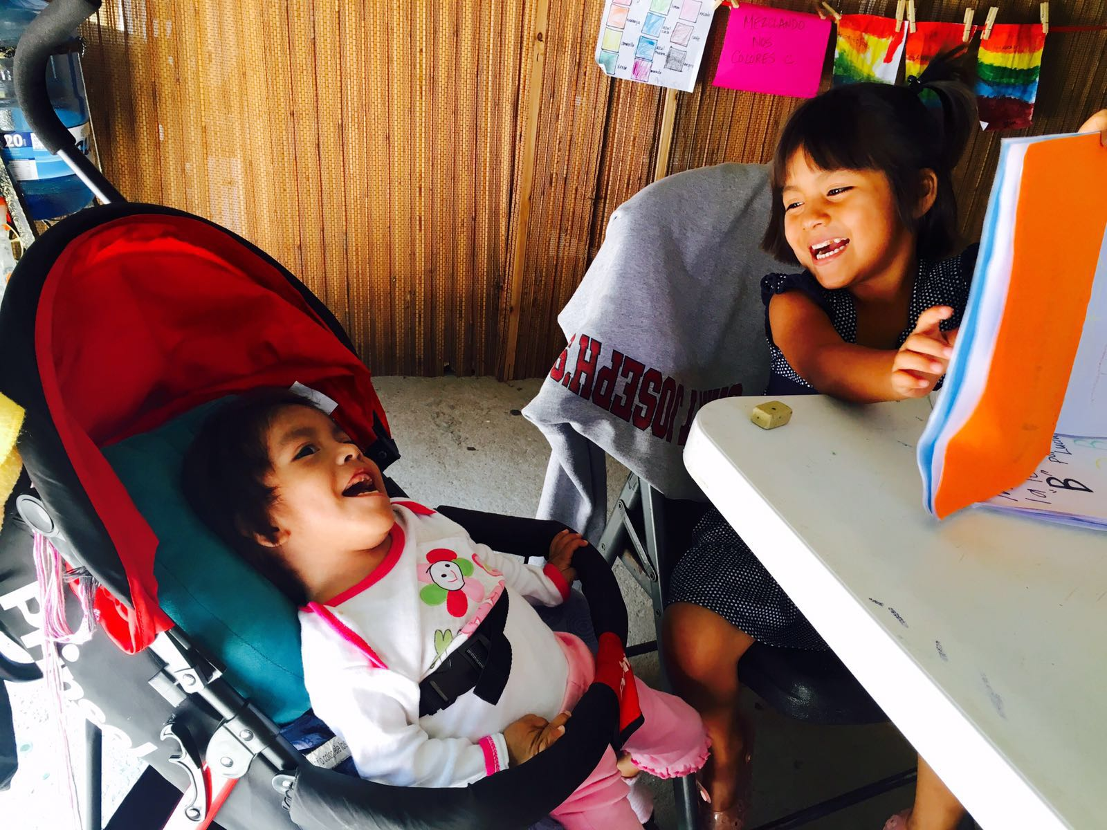 The children enjoy a good book and a good giggle at our children's home, Casa Hogar Simply Smiles! (August 2016)