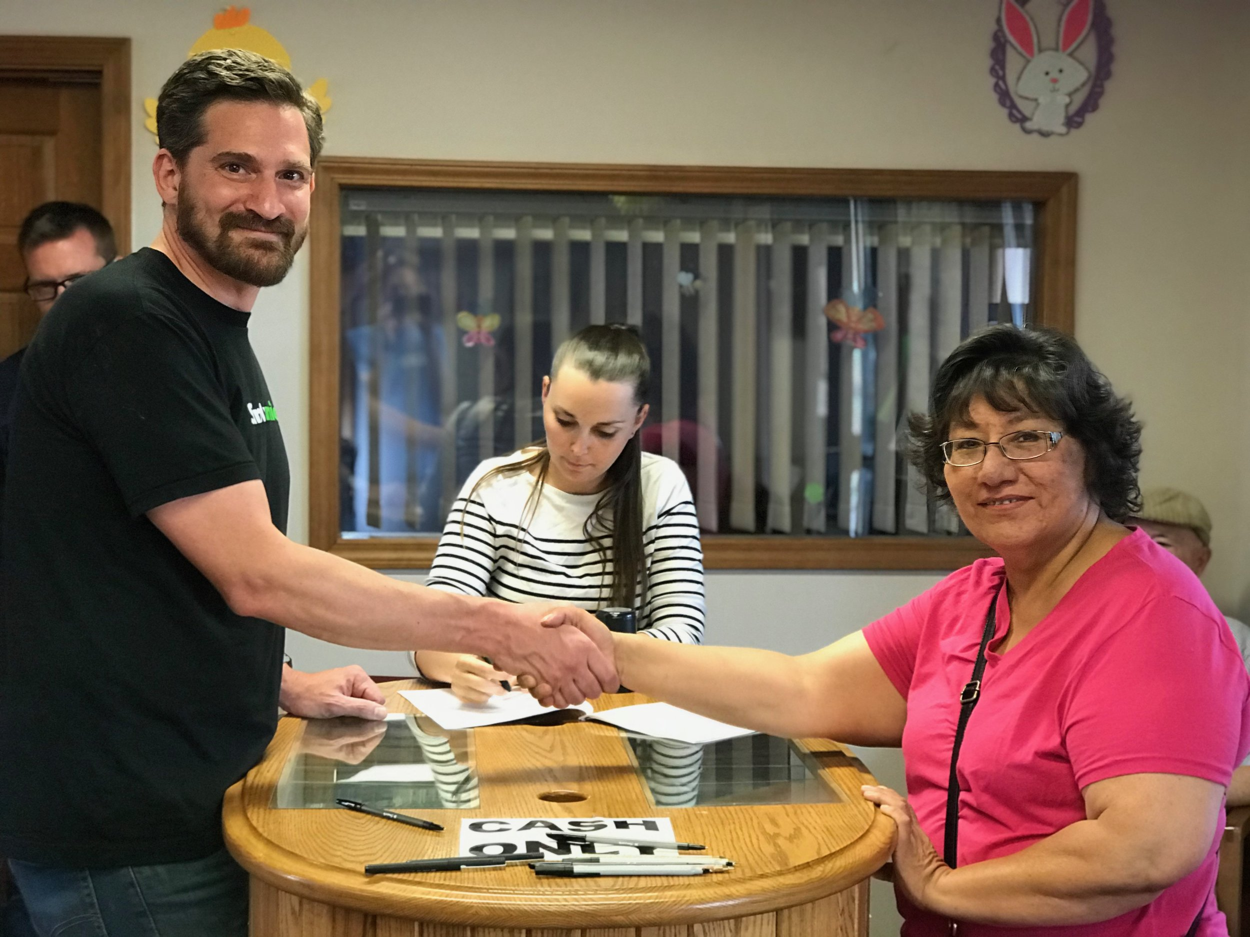 Deepening partnerships:  Bryan Nurnberger (left), Simply Smiles President and Founder and Toni Buffalo (right), Administrator of the Dakota Association of the United Church of Christ sign the 99-year lease agreement, allowing Simply Smiles to continue and expand its programming on the Cheyenne River Sioux Tribe Reservation in South Dakota.