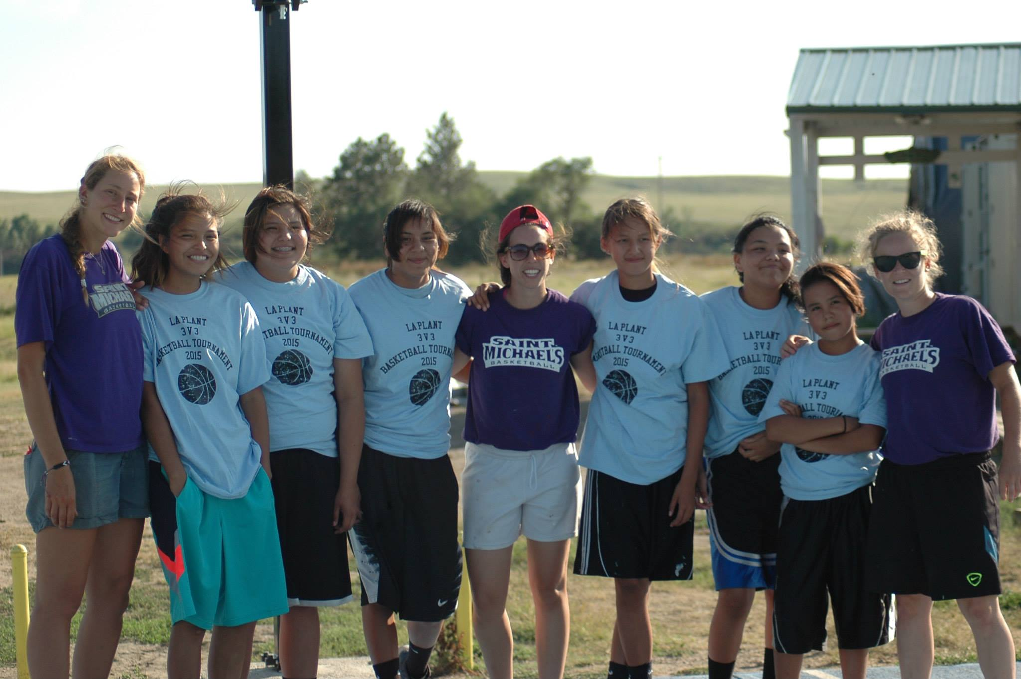 Teamwork makes the dreamwork:  Sam and her former college basketball teammates from Saint Michael's College in Vermont worked with teens on the Reservation to host a basketball tournament.