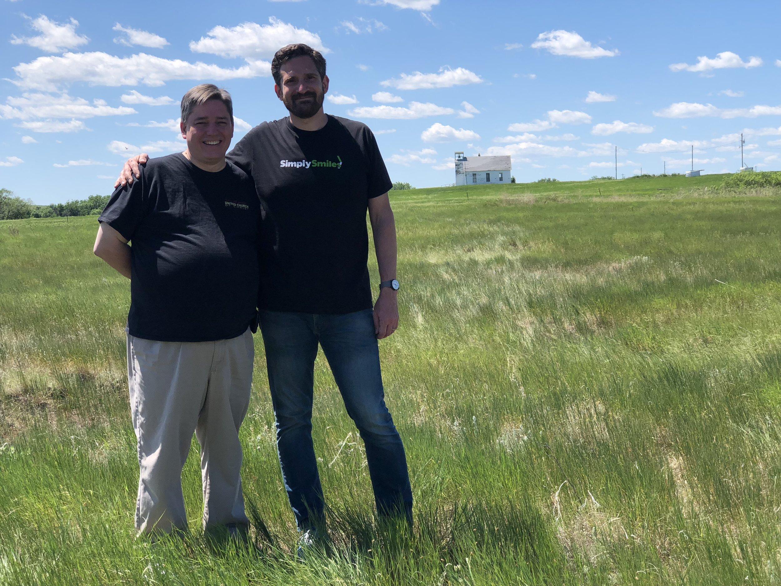 Rev. Gordon Rankin (left) with Bryan Nurnberger stand on the leased Dakota Association land in La Plant, South Dakota on the Cheyenne River Reservation.