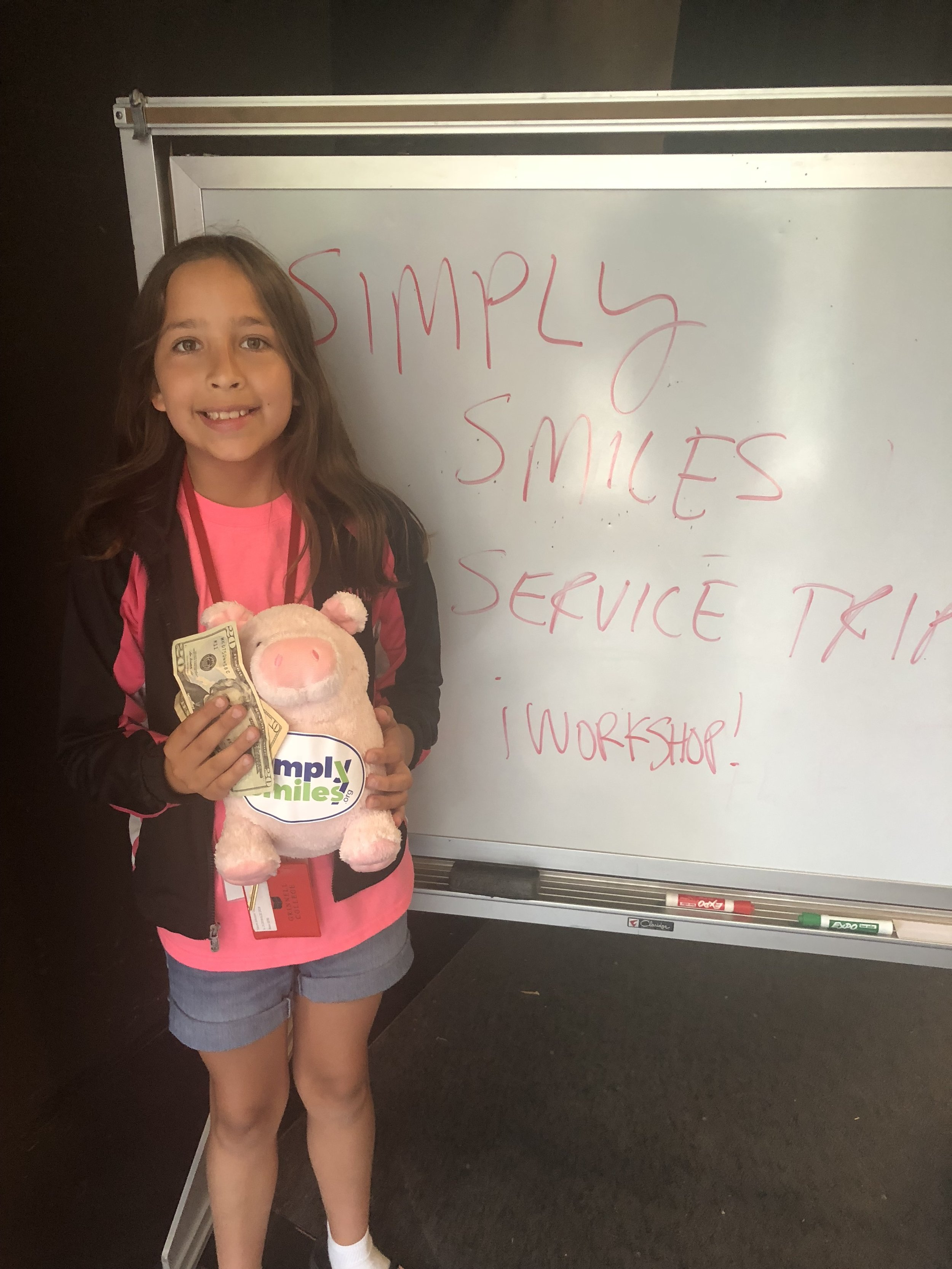 A young UCC member collecting donations for Simply Smiles at the 2018 Eastern Regional Youth Event after hearing President/Founder Bryan Nurnberger speak