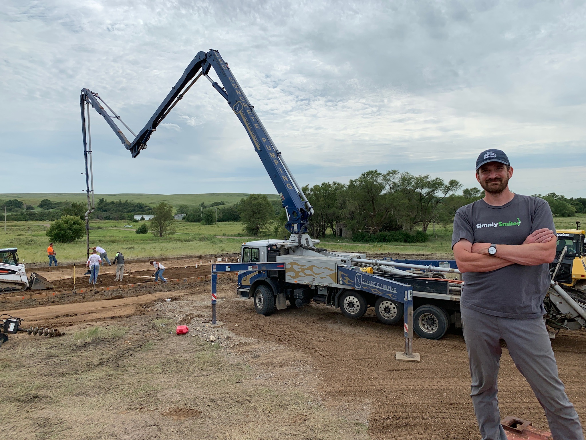 7/24/19: Simply Smiles President and Founder Bryan Nurnberger at the site of our Children's Village as the concrete slab is being poured.