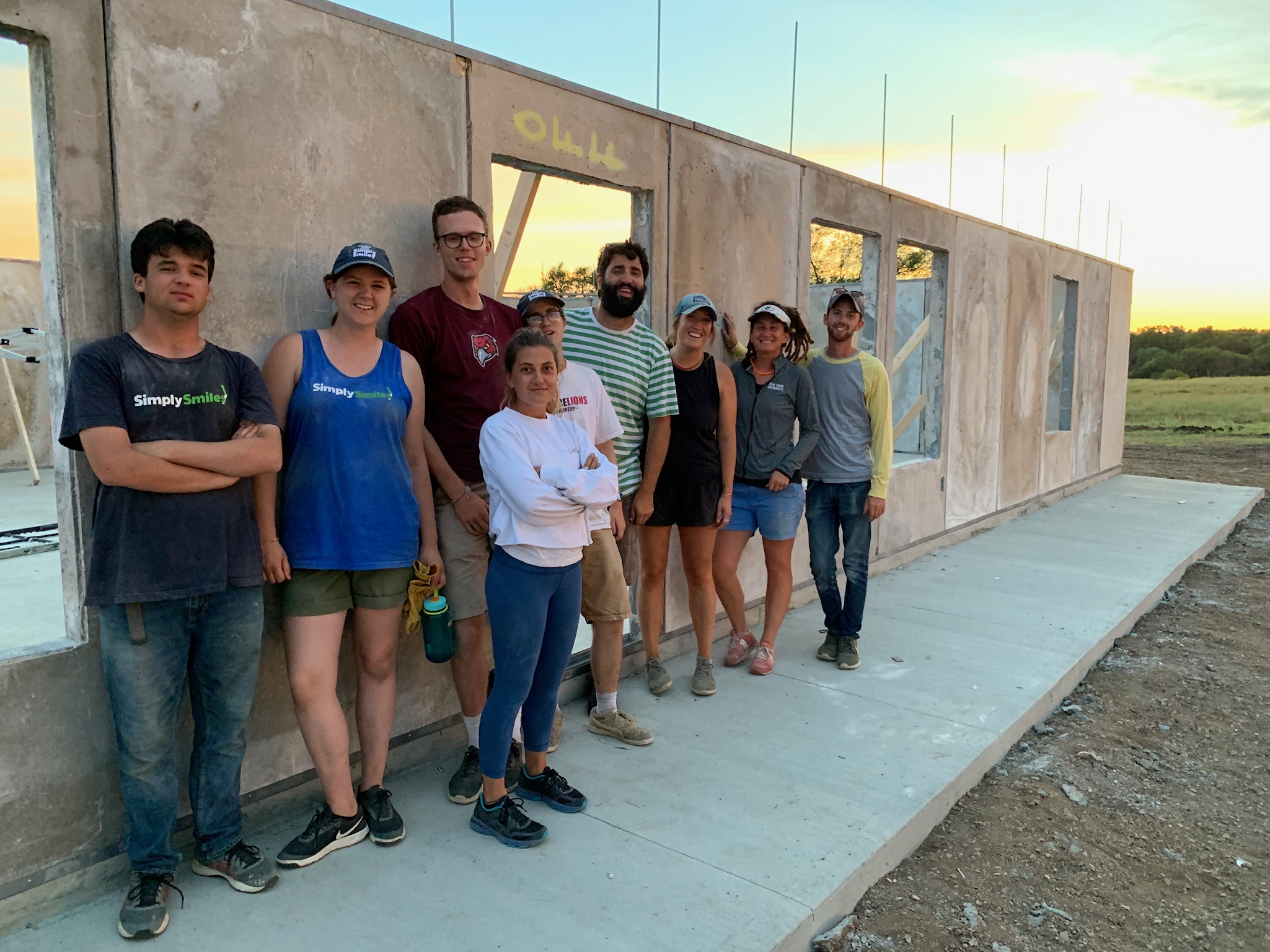 8/3/19: Simply Smiles staff and interns after a full day of construction and installing exterior walls.