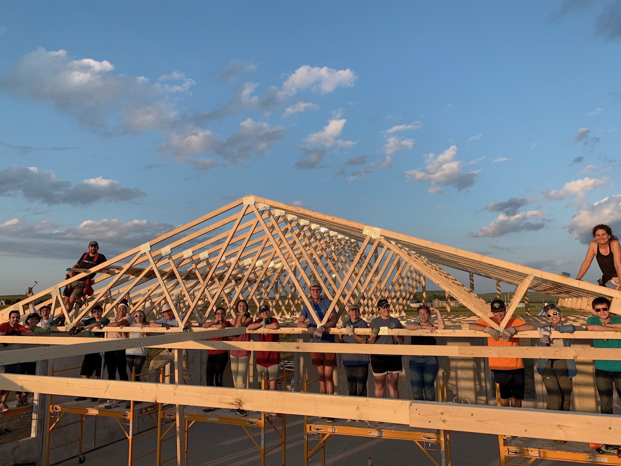 8/5/19: The first of the roof trusses are installed by amazing Simply Smiles volunteers and staff!
