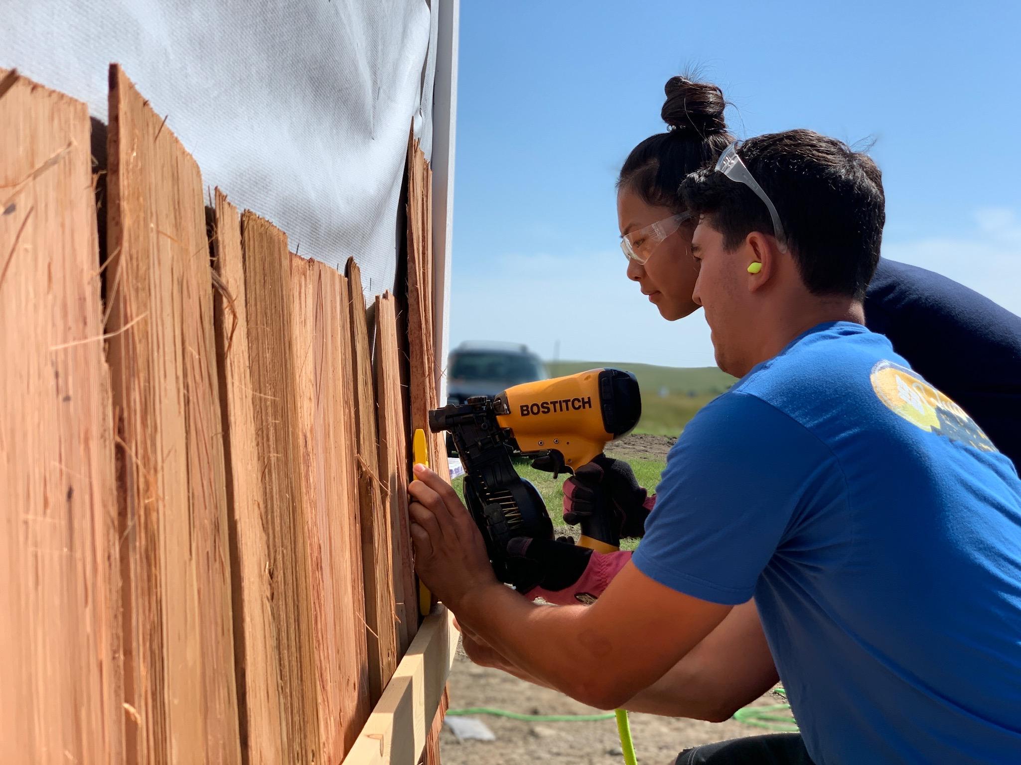 8/23/19: The University of Bridgeport volunteer team begins to install the cedar shingles.