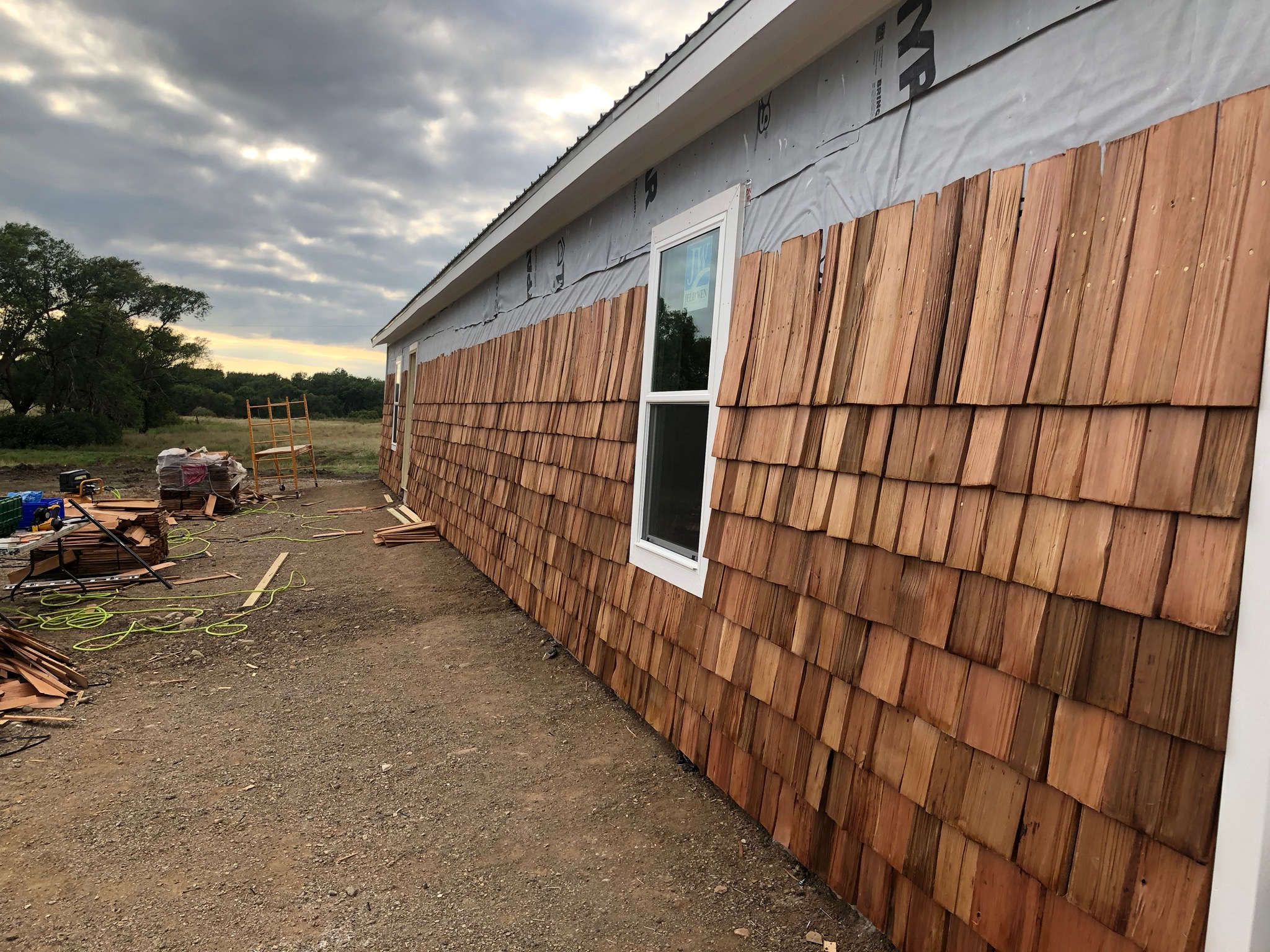 The exterior of the first building gets cedar shingles!