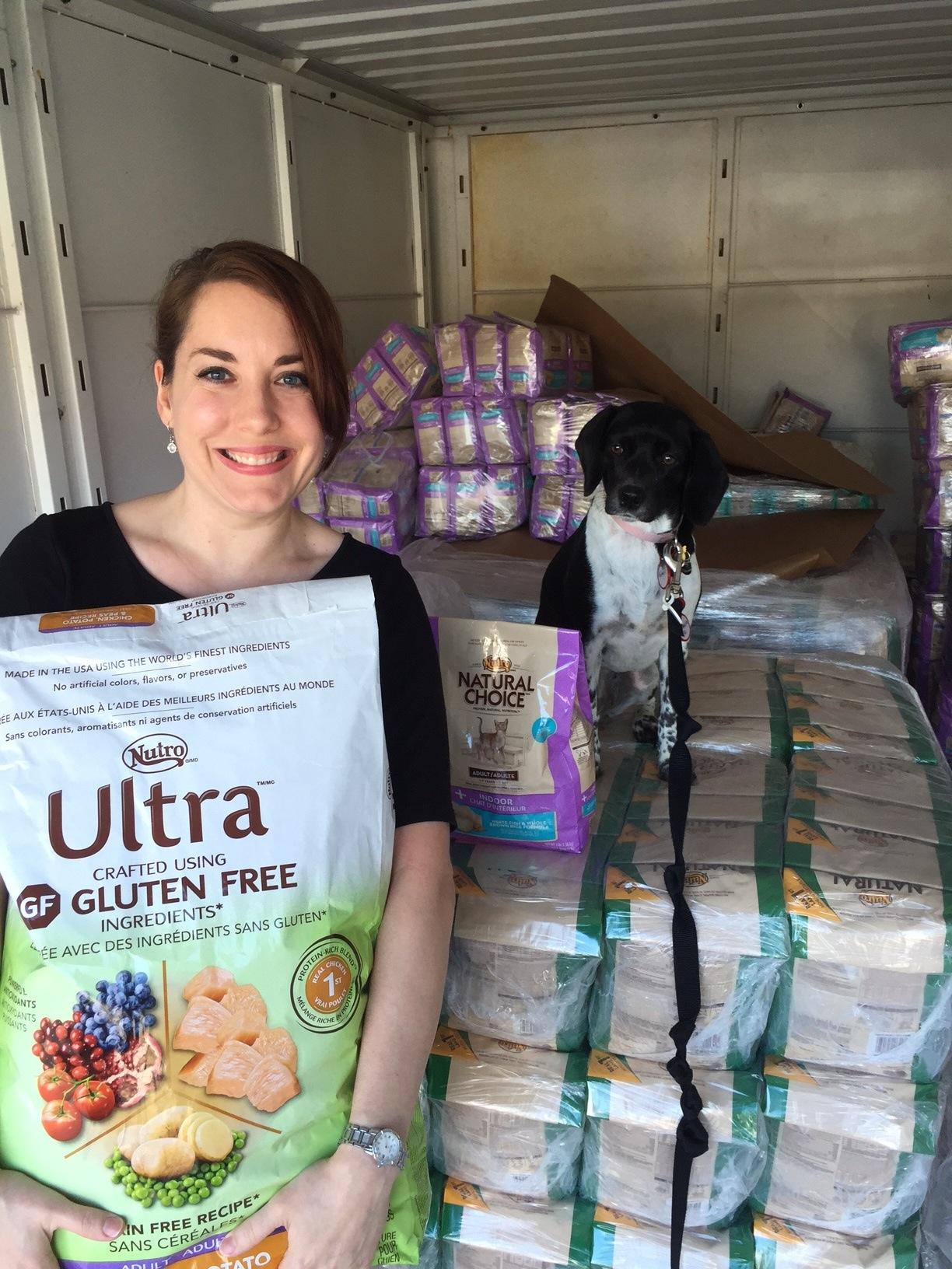 Copy of Volunteer with truck of pet food.