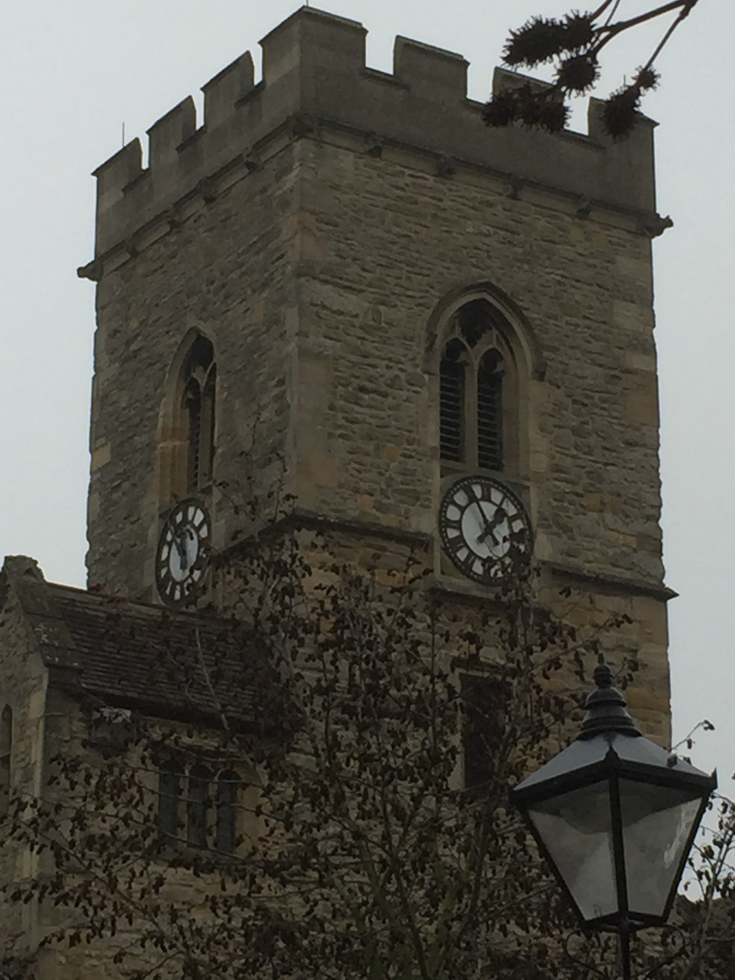 Clock faces of St Nicolas Church, Abingdon, showing sifferent times