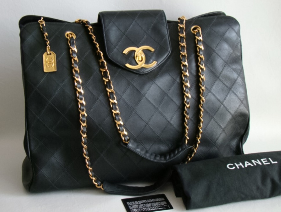 The Vintage Chanel Black XL Jumbo Weekender Overnighter Travel Tote Bag. Hellllloooo you need a bag to carry your things in to your Bestie date. This bag is HUGE by the way.