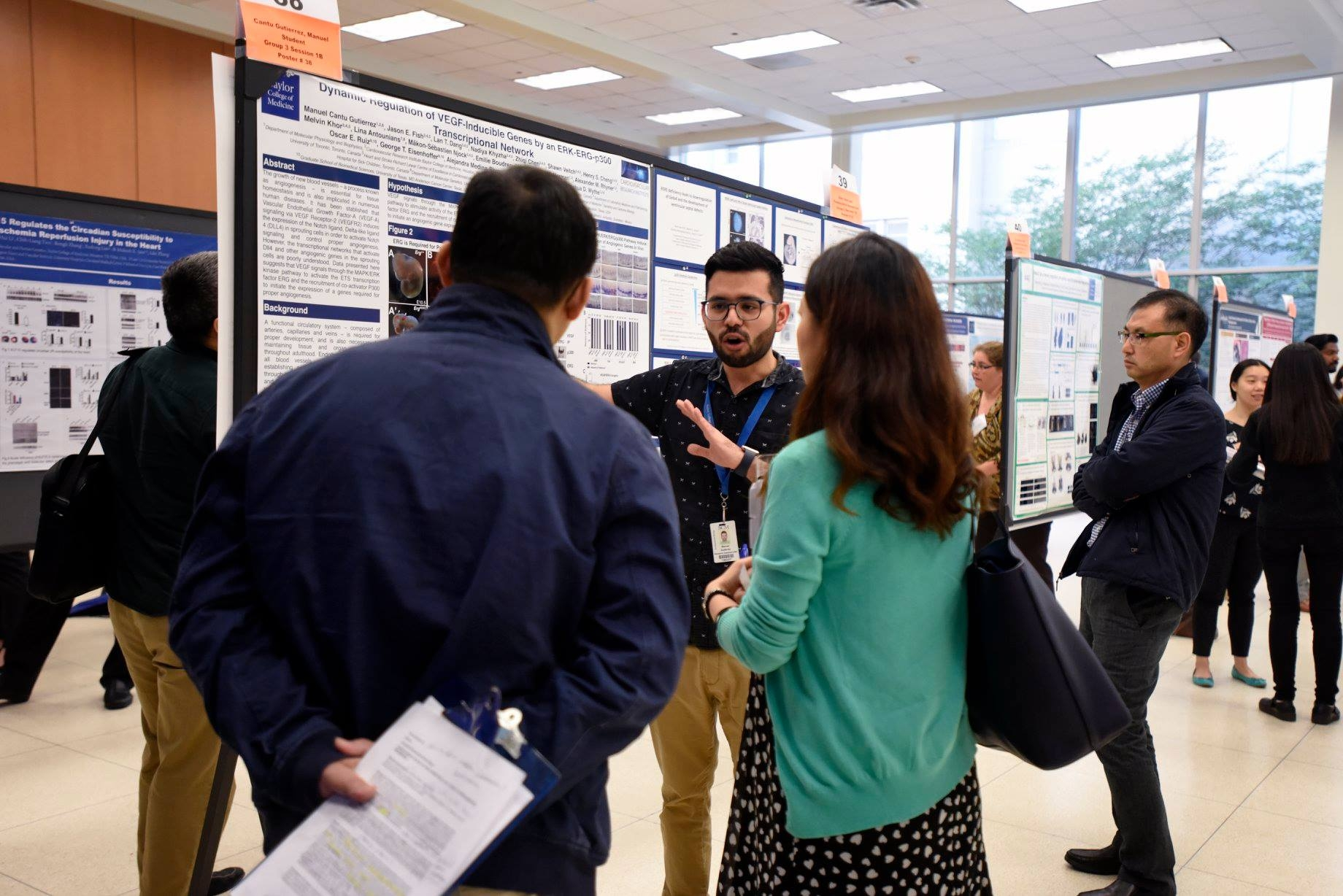 Manuel walking folks through his poster at the annual CVRI symposium in 2017 at BCM.
