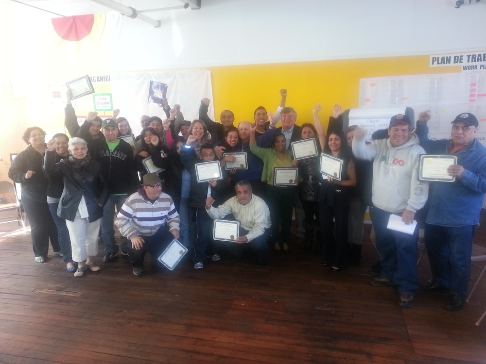 The graduates of the 2013 Workers' Compensation training with their diplomas