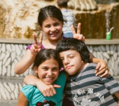 In the picture: three friends pose during Camp Rafiqi.