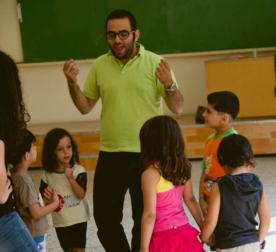 A supervisor leads a group of camp participants in an activity.