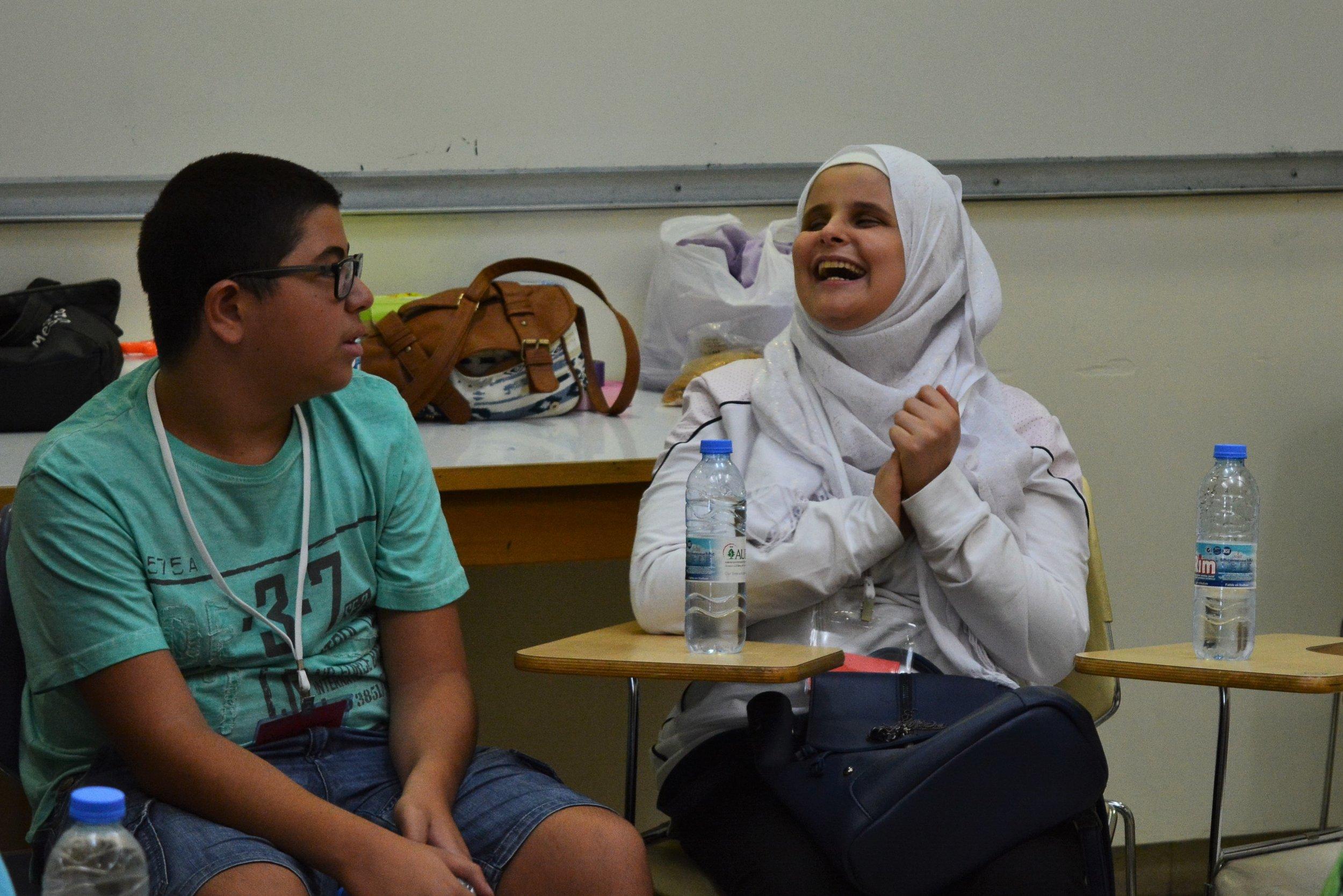In the picture: a female participant (right) laughs alongside a male participant (left).