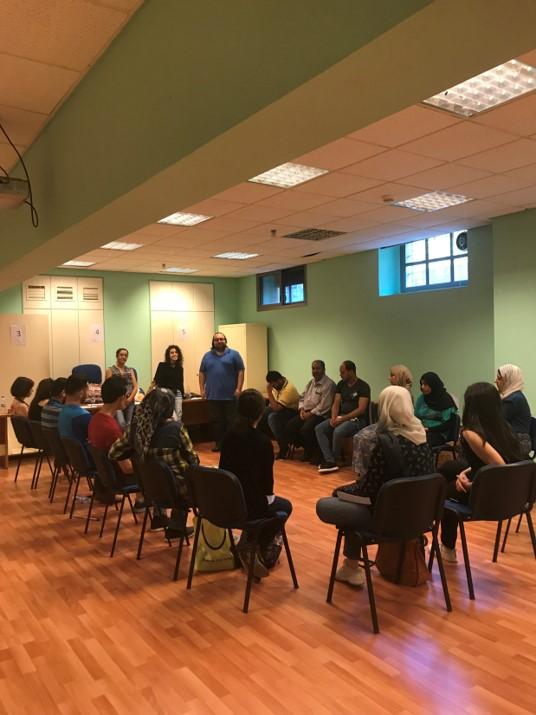Volunteers attending training in Social Literacy topics