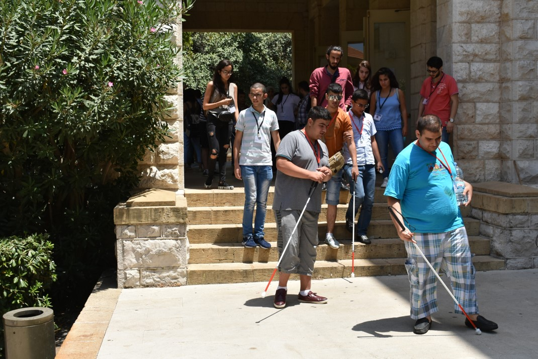 Visually impaired participants and volunteers descending stairs during O&M lesson