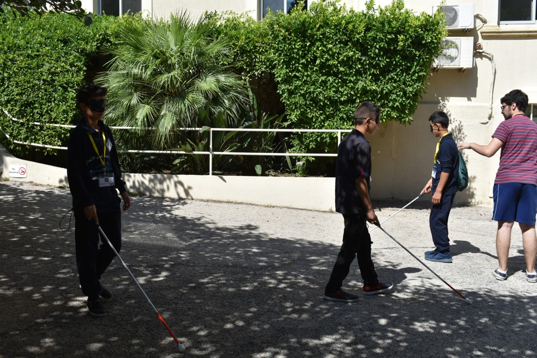 Visually impaired participants learning how to use the white cane during O&M lesson