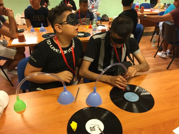 Visually impaired participants preparing their own record players during science class
