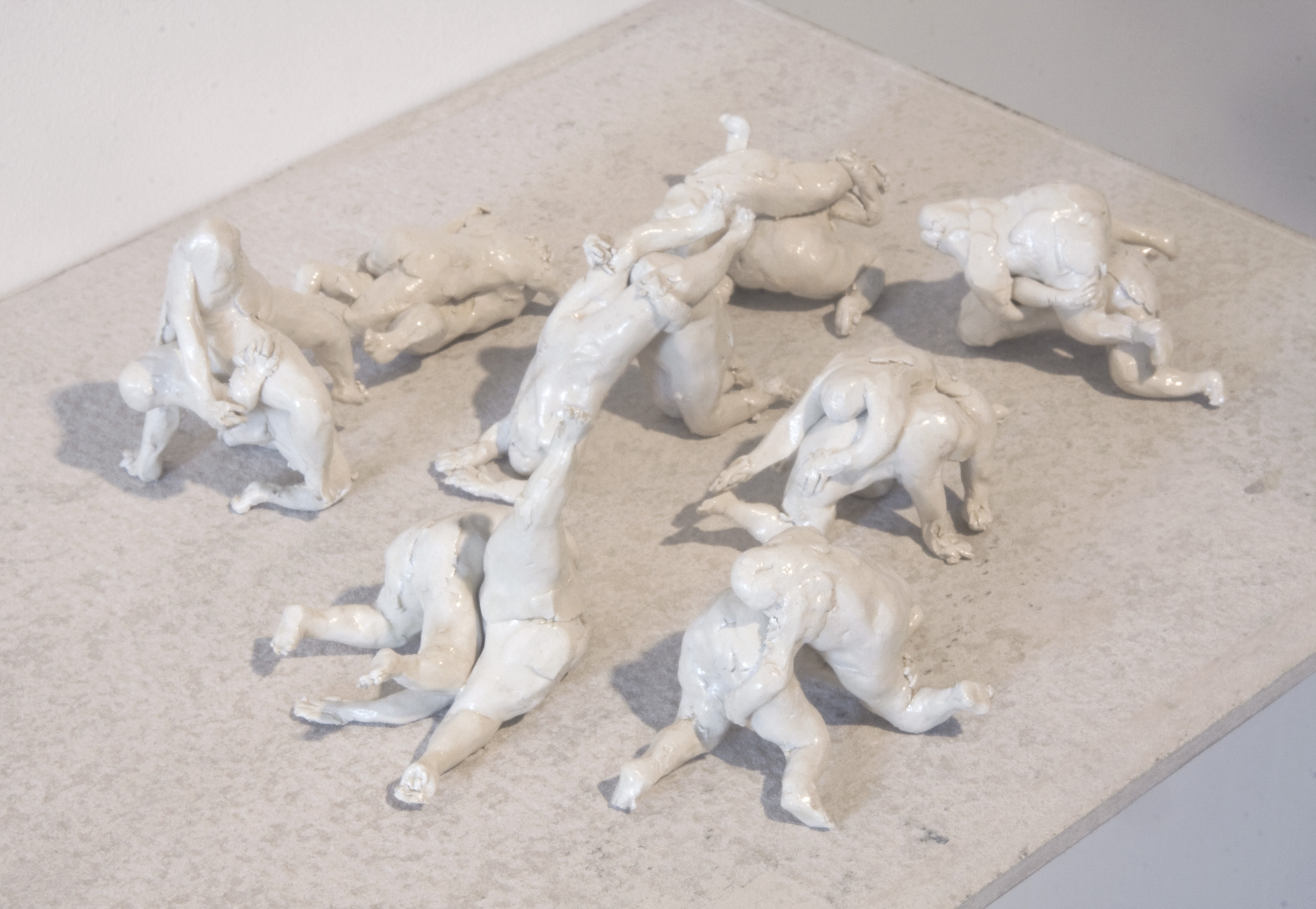 Wrestlers (figures) , clay, enamel and concrete shelf. Collaborative work with  Llewellyn Millhouse .