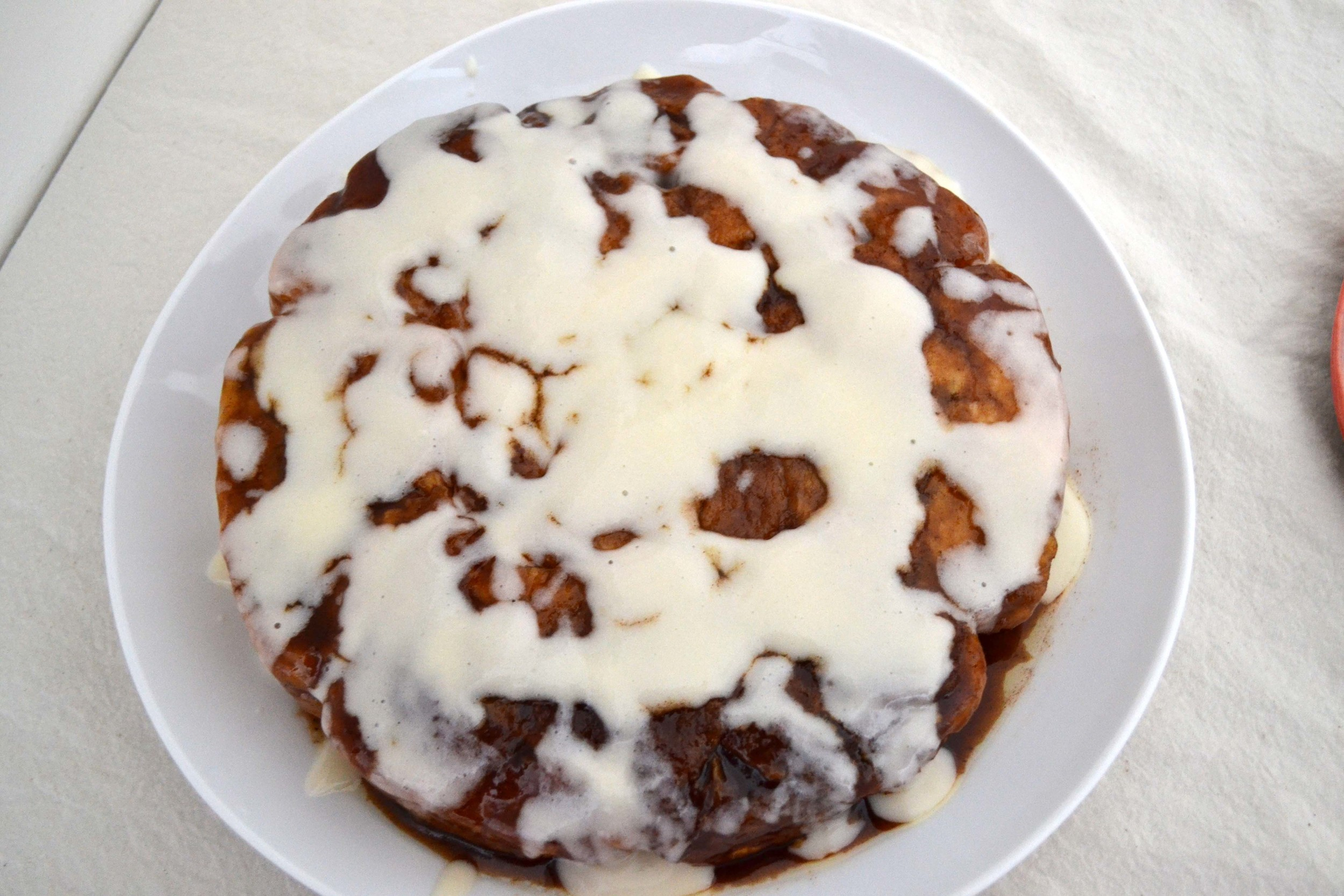 Xander's cinnamon rolls. A biscuit-like crumb with cinnamon spice-y flavors, and cream cheese glaze.