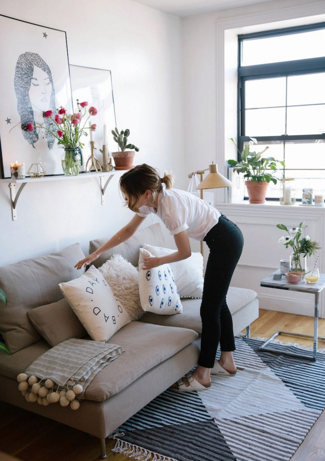 This tiny neutral living room is just adorable. Image via  Urban Outfitters blog .